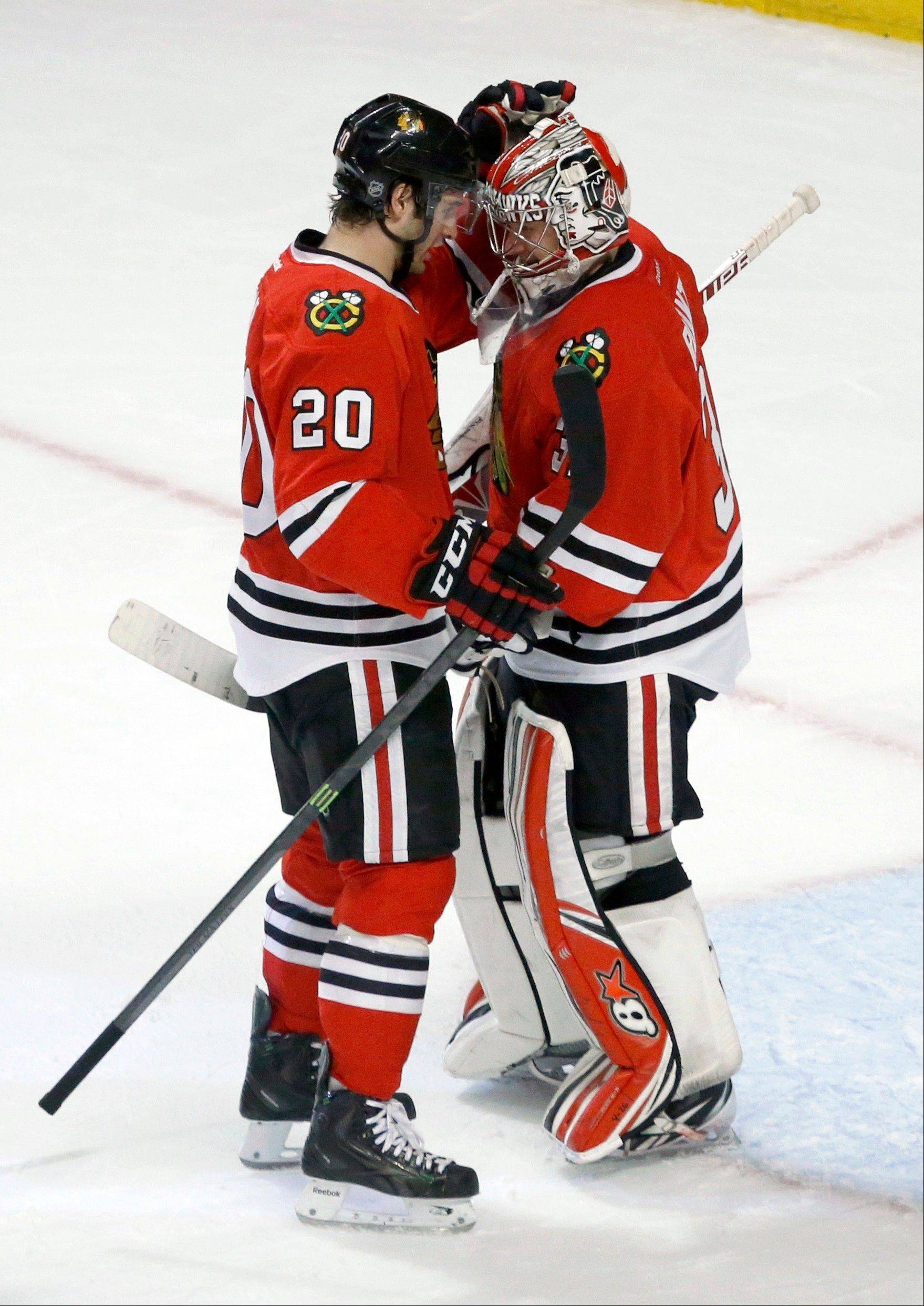 Brandon Saad, who scored the only goal, and rookie Antti Raanta, who recorded his first NHL shutout, celebrate the Blackhawks' 1-0 win over the Kings at the United Center on Monday night.