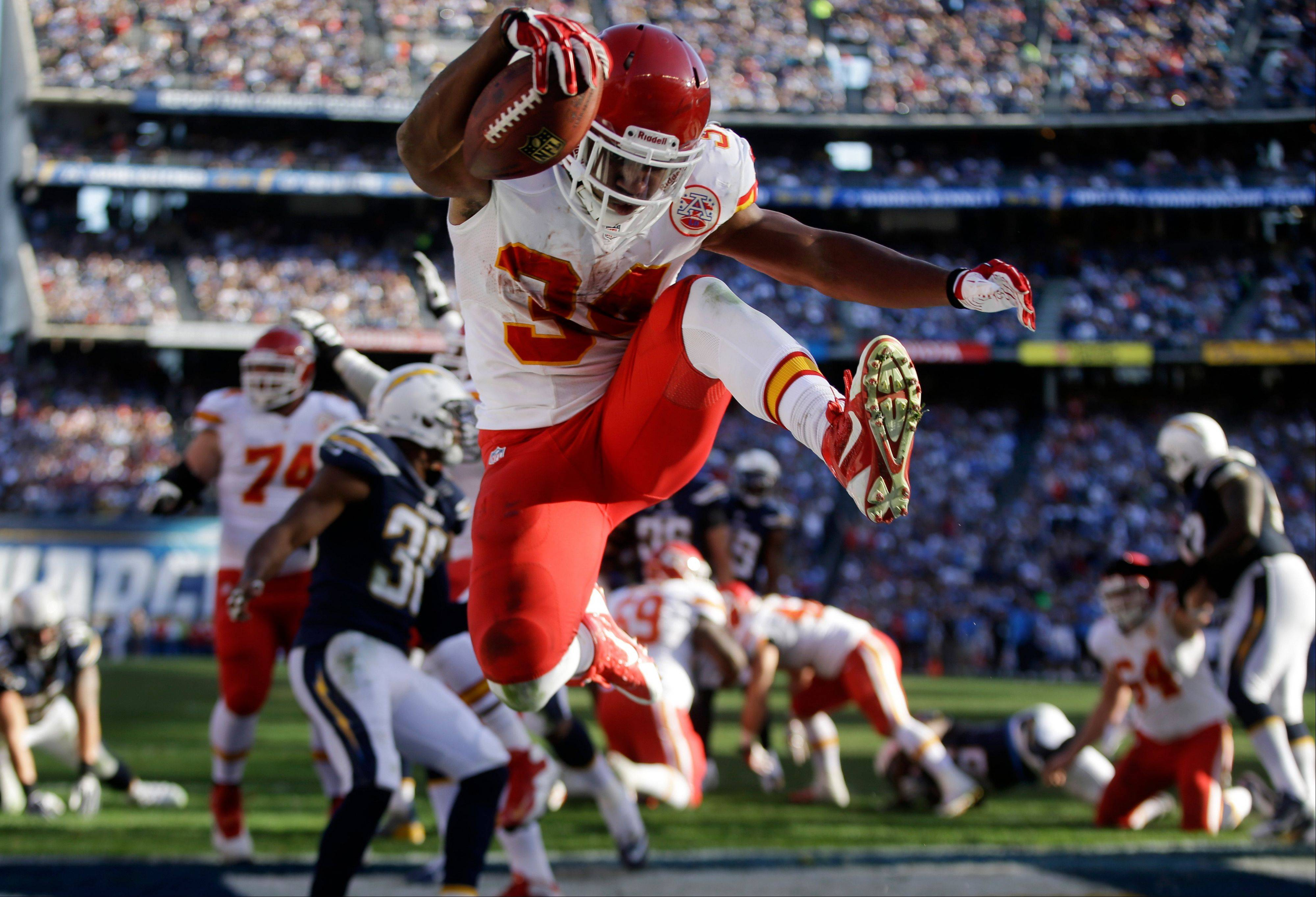 Kansas City Chiefs reserve running back Knile Davis jumps in the end zone as he scores a touchdown against the Chargers during the first half of Sunday�s game in San Diego.