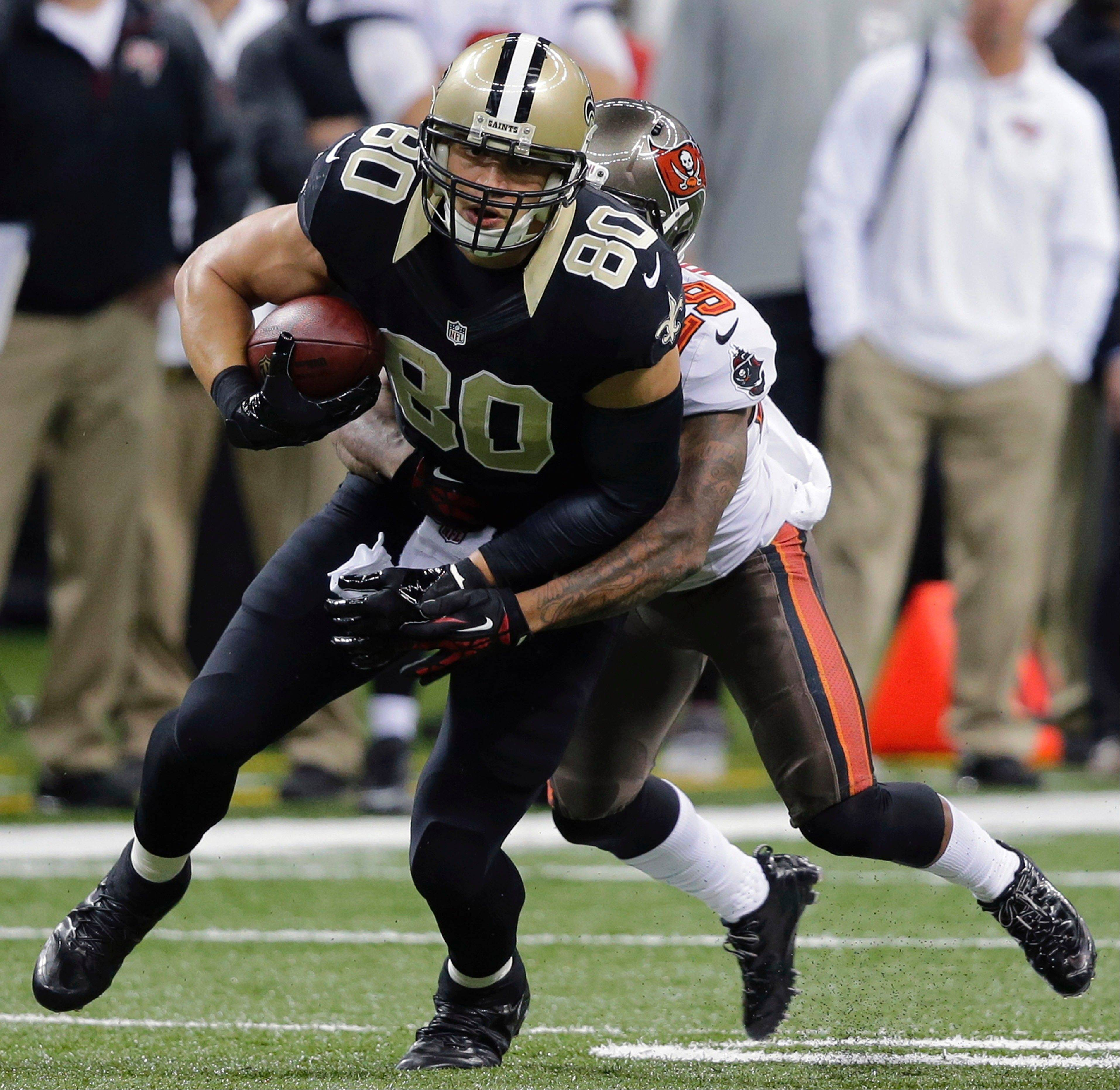 Saints tight end Jimmy Graham is tackled by Tampa Bay Buccaneers cornerback Leonard Johnson in the first half of Sunday�s game in New Orleans.