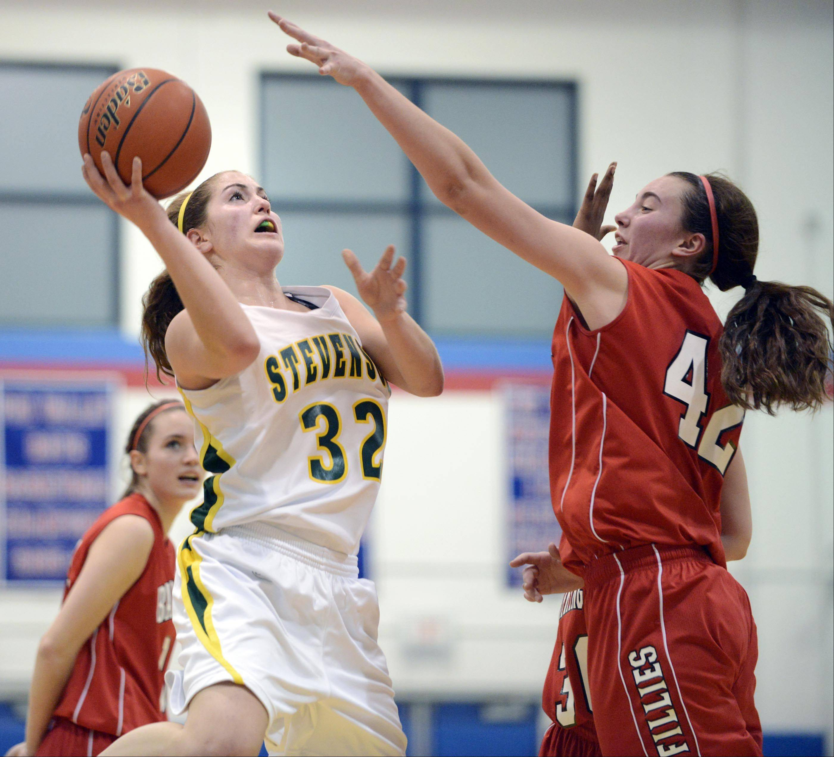 Stevenson's Sophia Way shoots over Barrington's Megan Talbot in the 31st Charger Classic at Dundee-Crown on Monday.