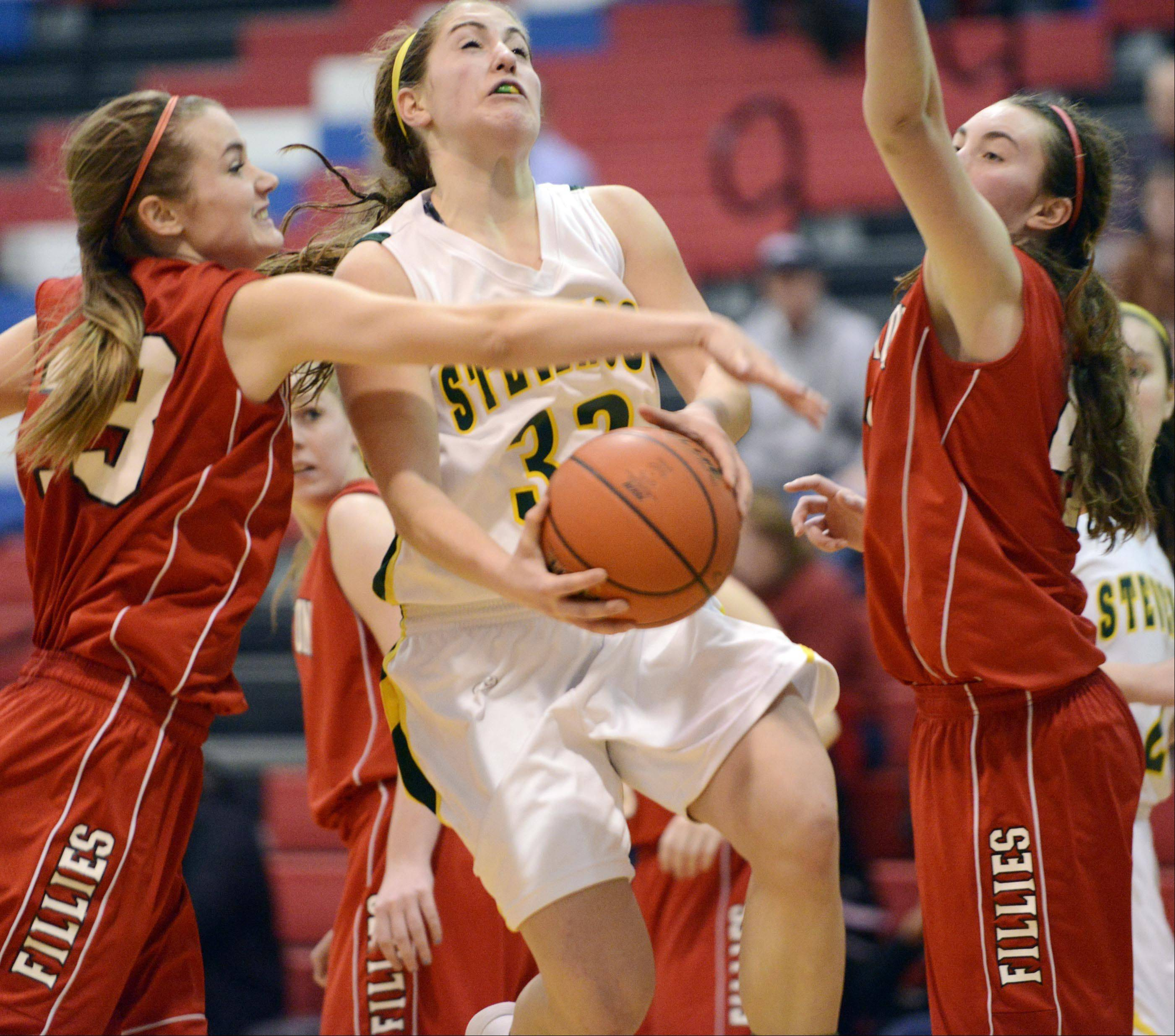 Barrington�s Angie Kirchoff tries to block a shot by Stevenson�s Sophia Way.