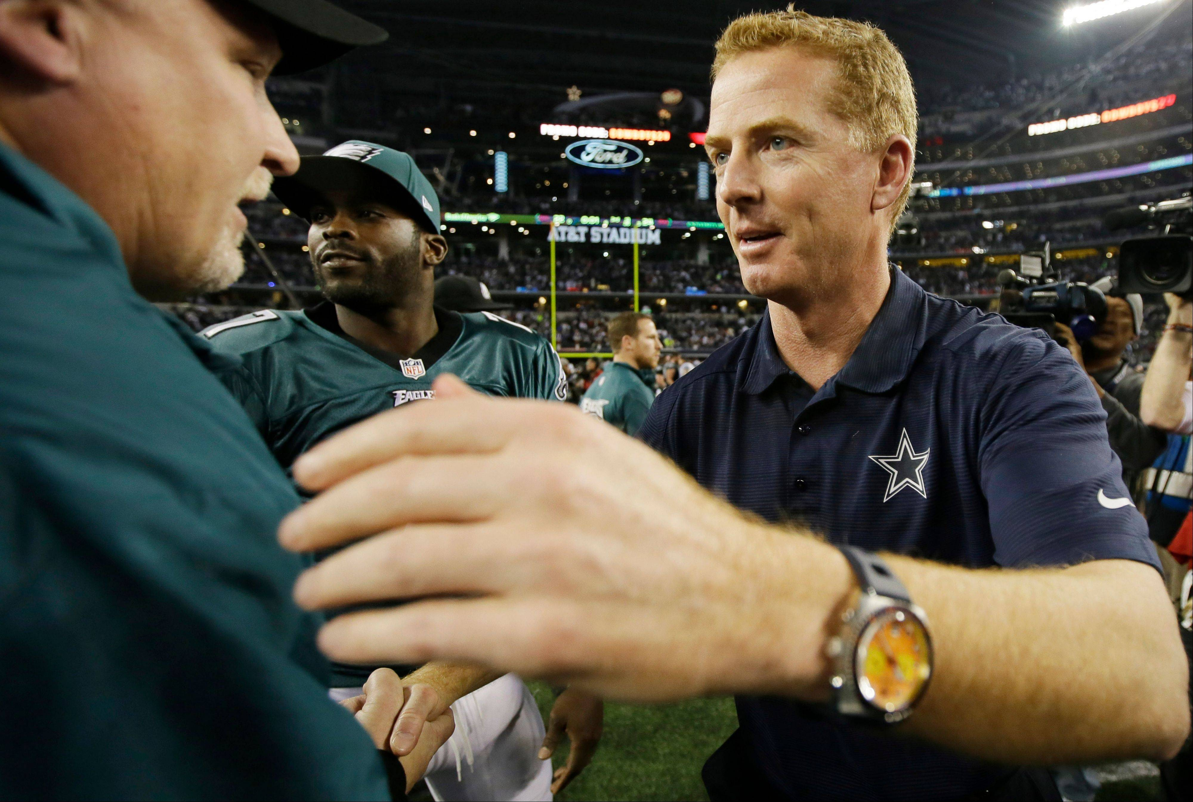 Dallas Cowboys head coach Jason Garrett greets members of the Philadelphia Eagles after Sunday�s game in Arlington, Texas. The Eagles won 24-22.
