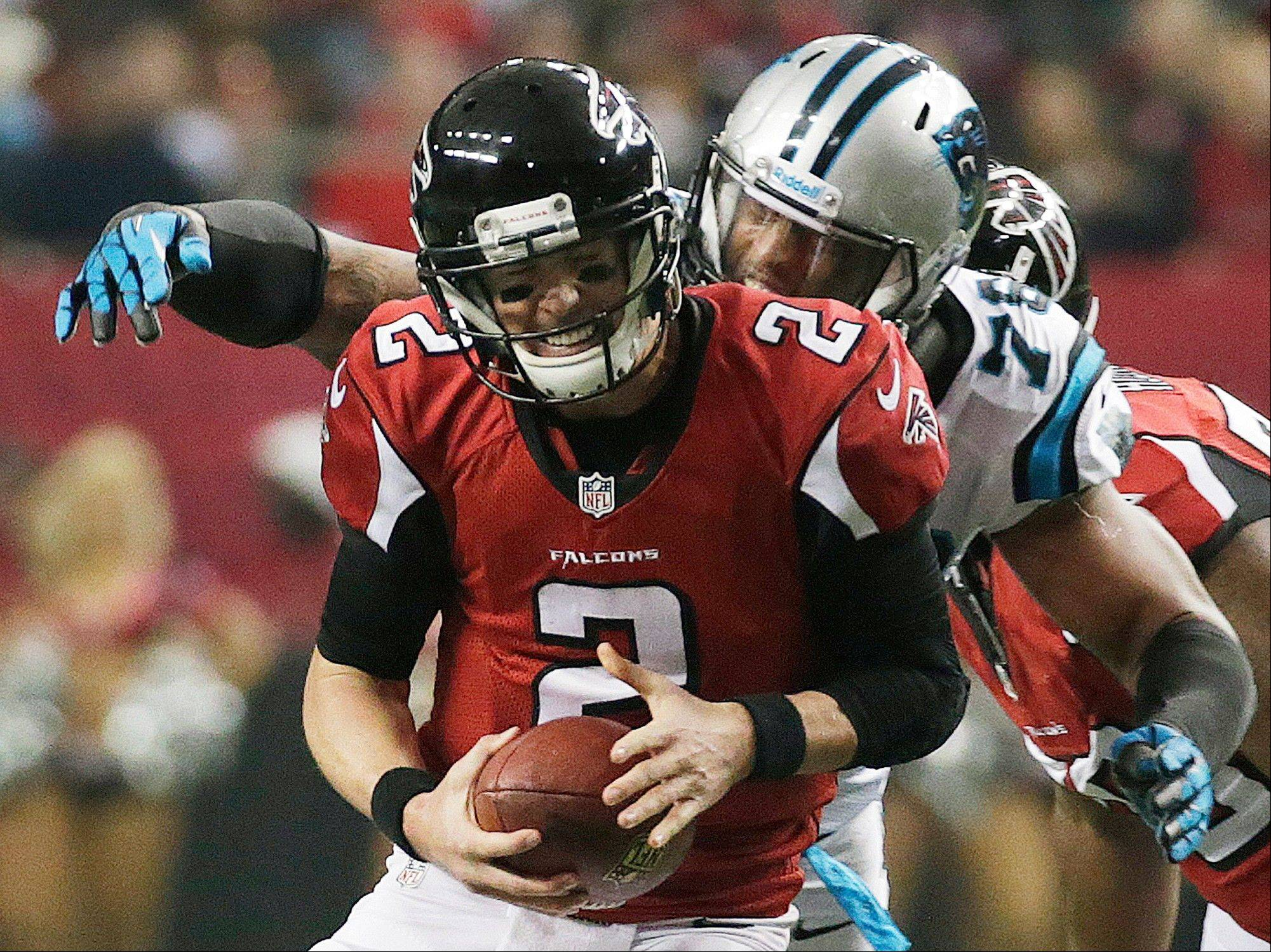 Falcons quarterback Matt Ryan is sacked by Carolina Panthers guard Nate Chandler during the first half of Sunday�s game in Atlanta.