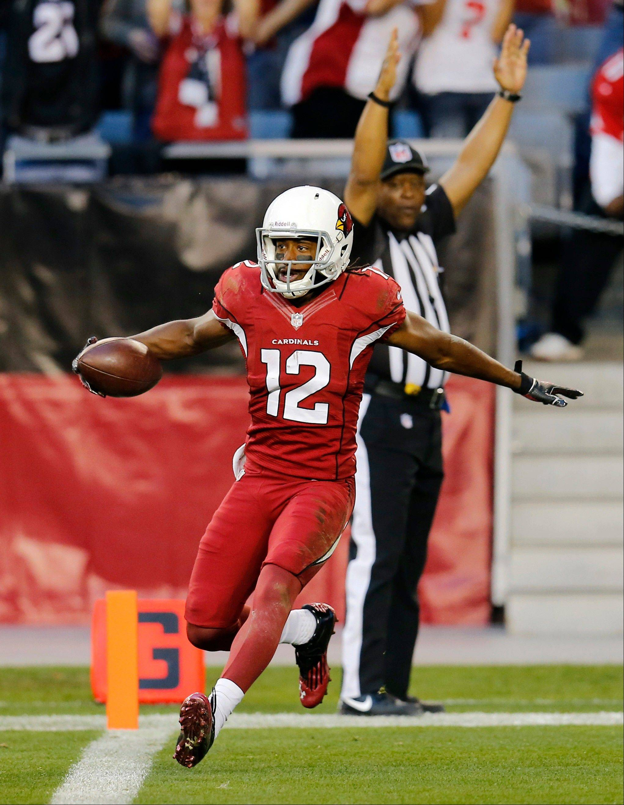 Arizona Cardinals wide receiver Andre Roberts celebrates his touchdown against the San Francisco 49ers during the second half of Sunday�s game in Glendale, Ariz.