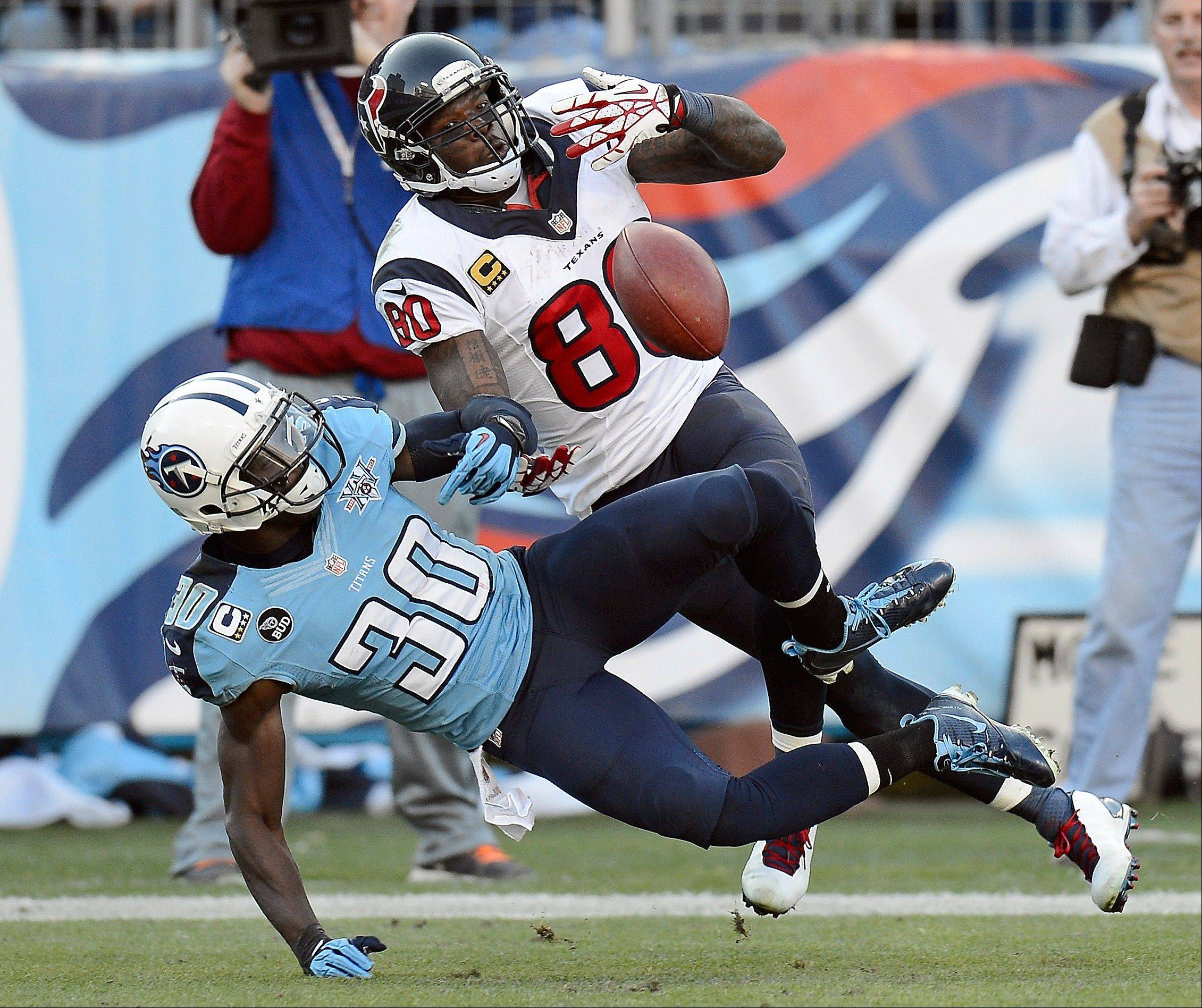 Tennessee Titans cornerback Jason McCourty, left, breaks up a pass intended for Houston Texans wide receiver Andre Johnson in the fourth quarter of Sunday�s game in Nashville, Tenn.