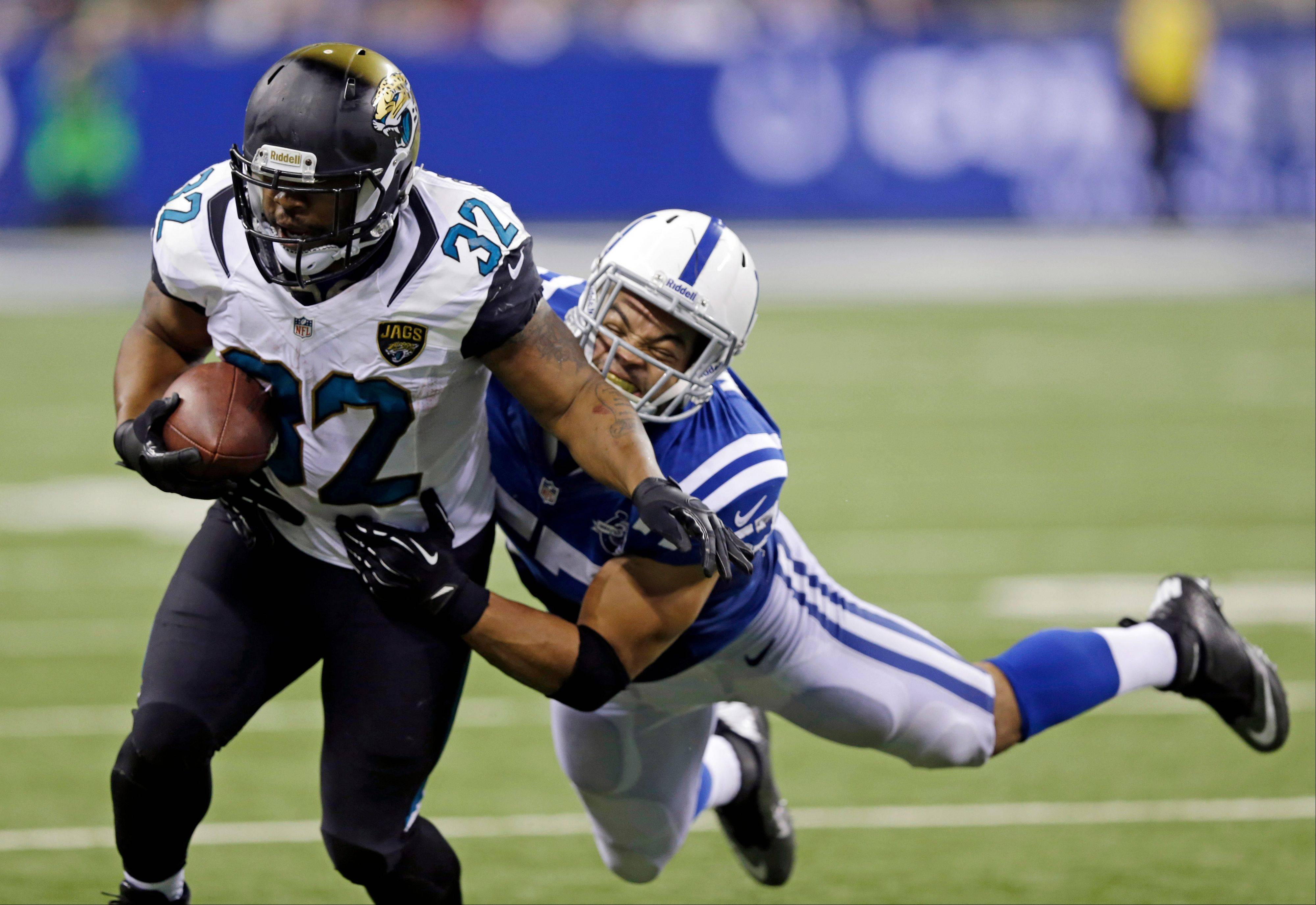 Jacksonville�s Maurice Jones-Drew is tackled by the Colts� Josh McNary during the second half of Sunday�s game in Indianapolis. His eighth season with the Jaguars might have been his last.