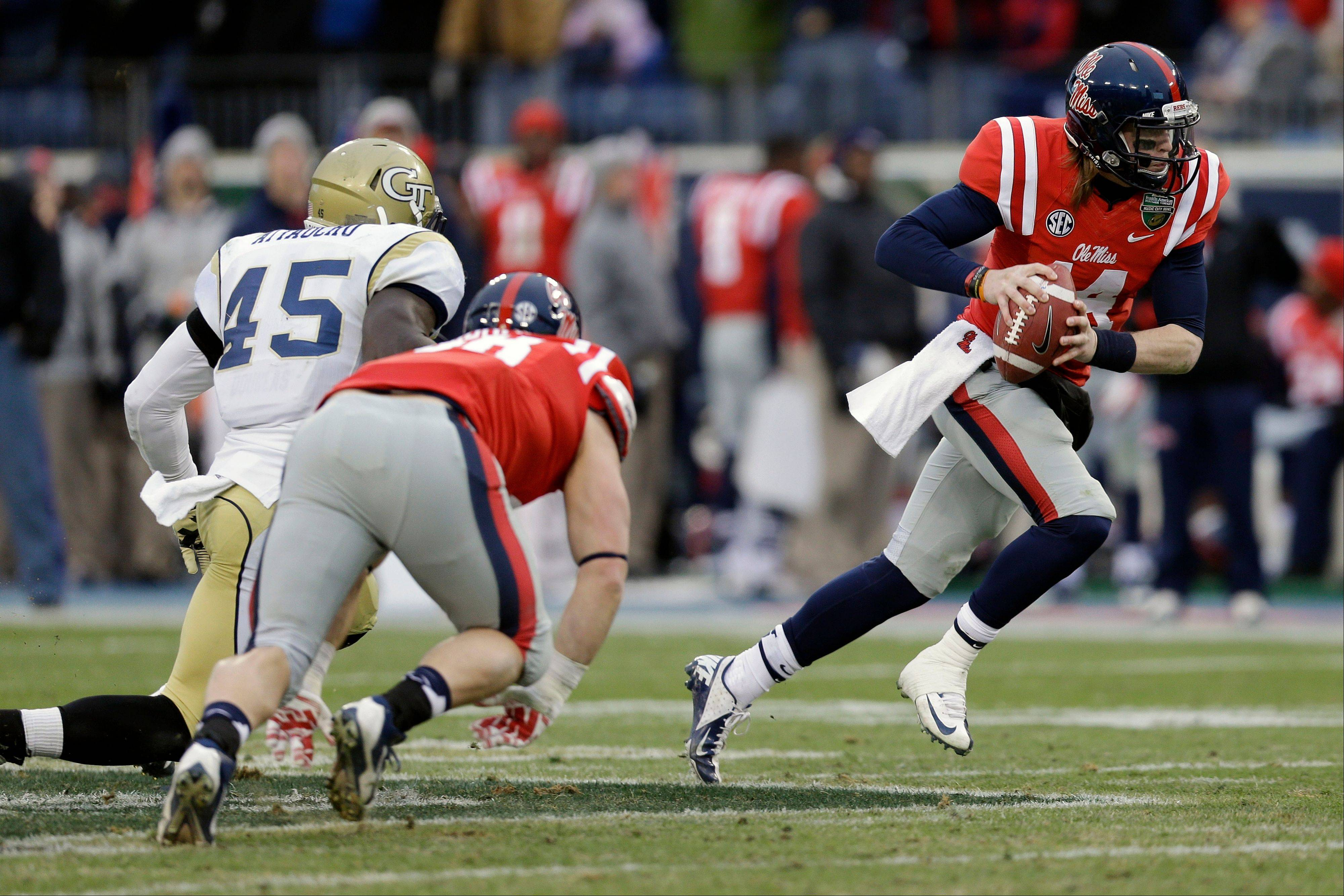 Associated Press Mississippi quarterback Bo Wallace scrambles past Georgia Tech defensive end Jeremiah Attaochu in the second quarter of the Music City Bowl on Monday in Nashville, Tenn.
