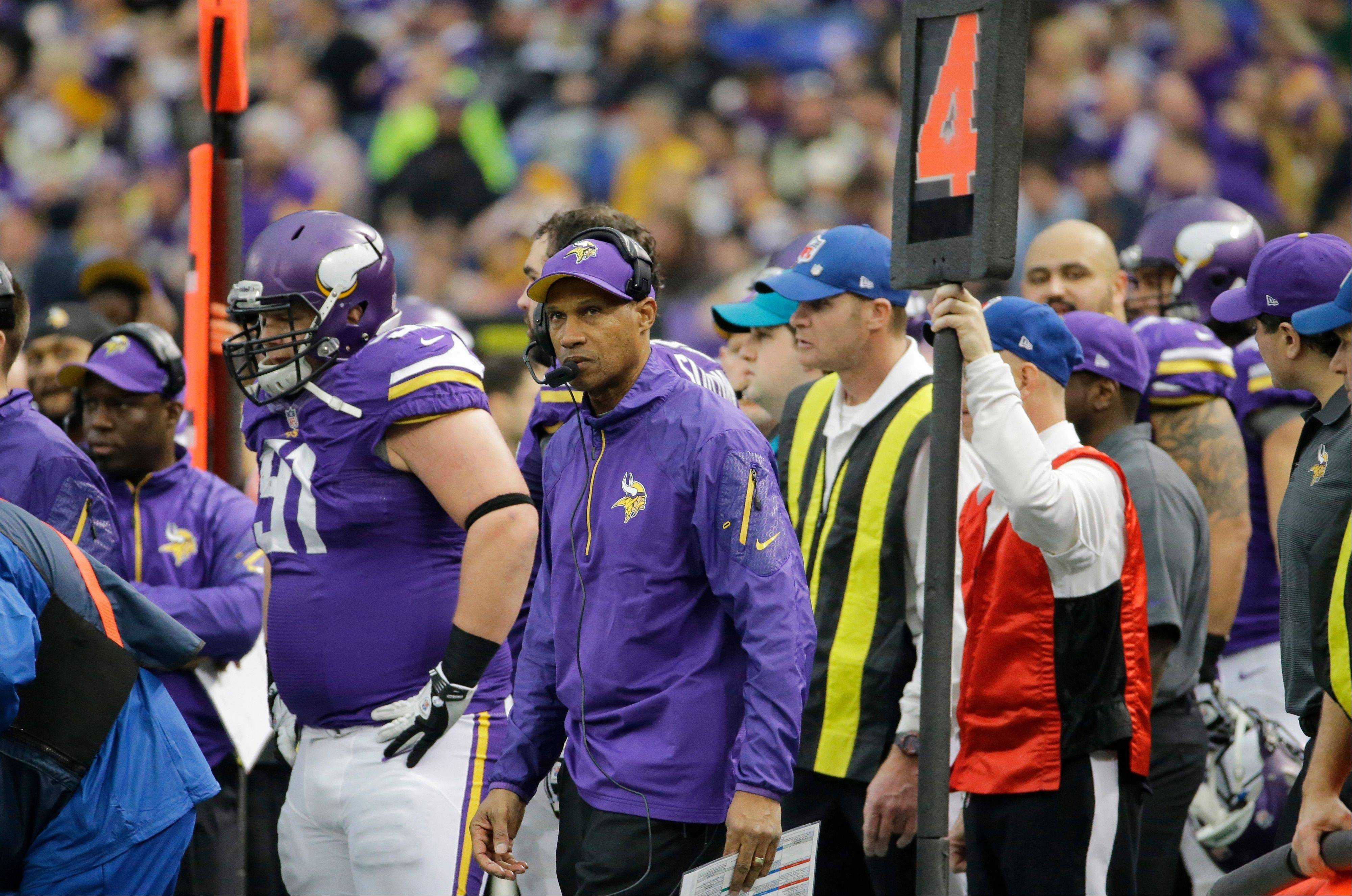 Minnesota Vikings head coach Leslie Frazier, center, watches from the sidelines Sunday during the second half against the Detroit Lions in Minneapolis. The Vikings fired Frazier Monday morning.