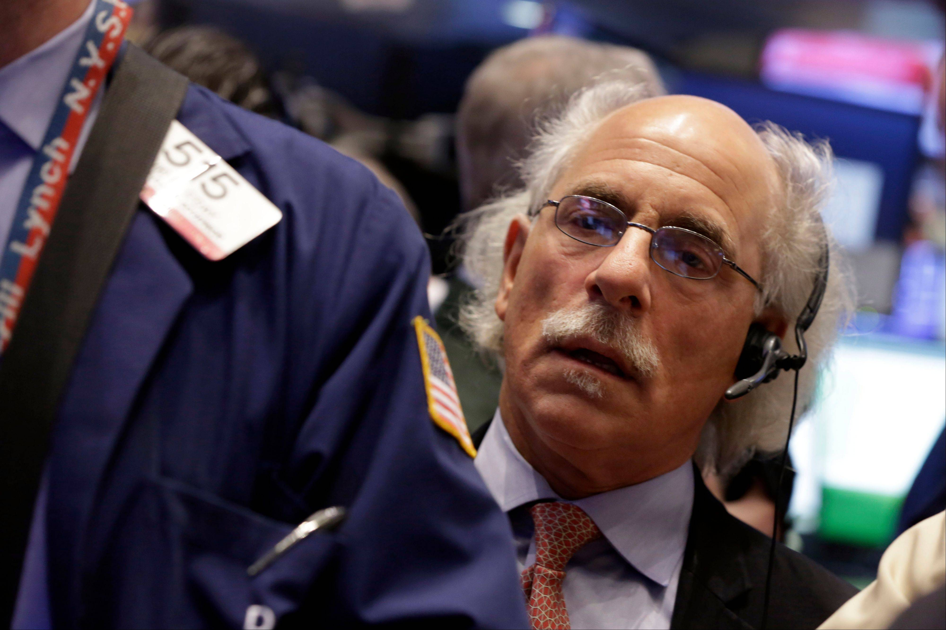 Stocks were little changed Monday, after the Standard & Poor's 500 Index reached an all-time high last week and headed toward its biggest annual gain since 1997.