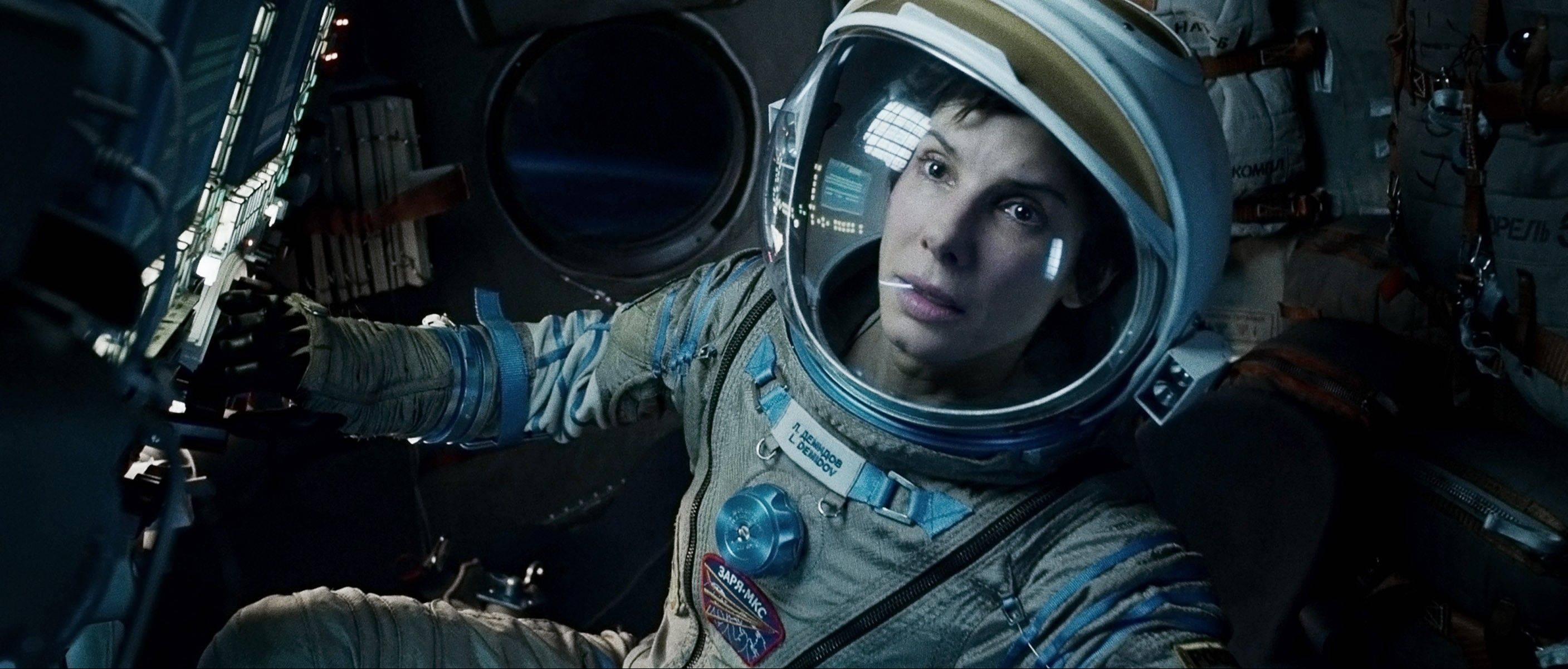 "Warner Bros.' ""Gravity"" has earned $254 million domestically. Hollywood is expected to have a banner year as box office totals are projected to peak at just under $11 billion, bringing in more theater revenue in 2013 than ever before."
