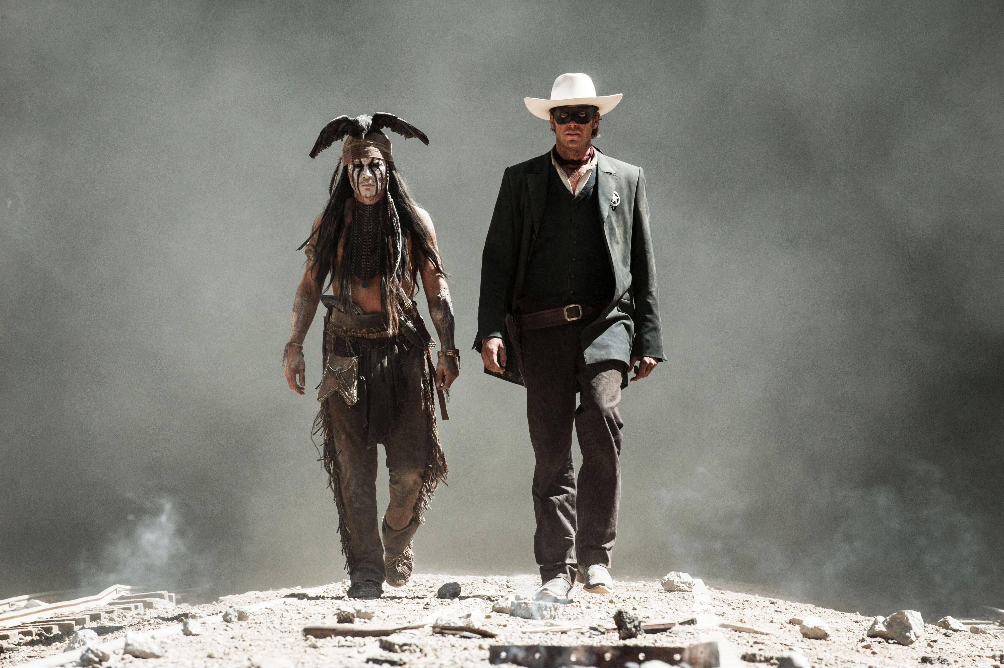 "Johnny Depp, left, plays Tonto and Armie Hammer is The Lone Ranger in Disney's ""The Lone Ranger."""