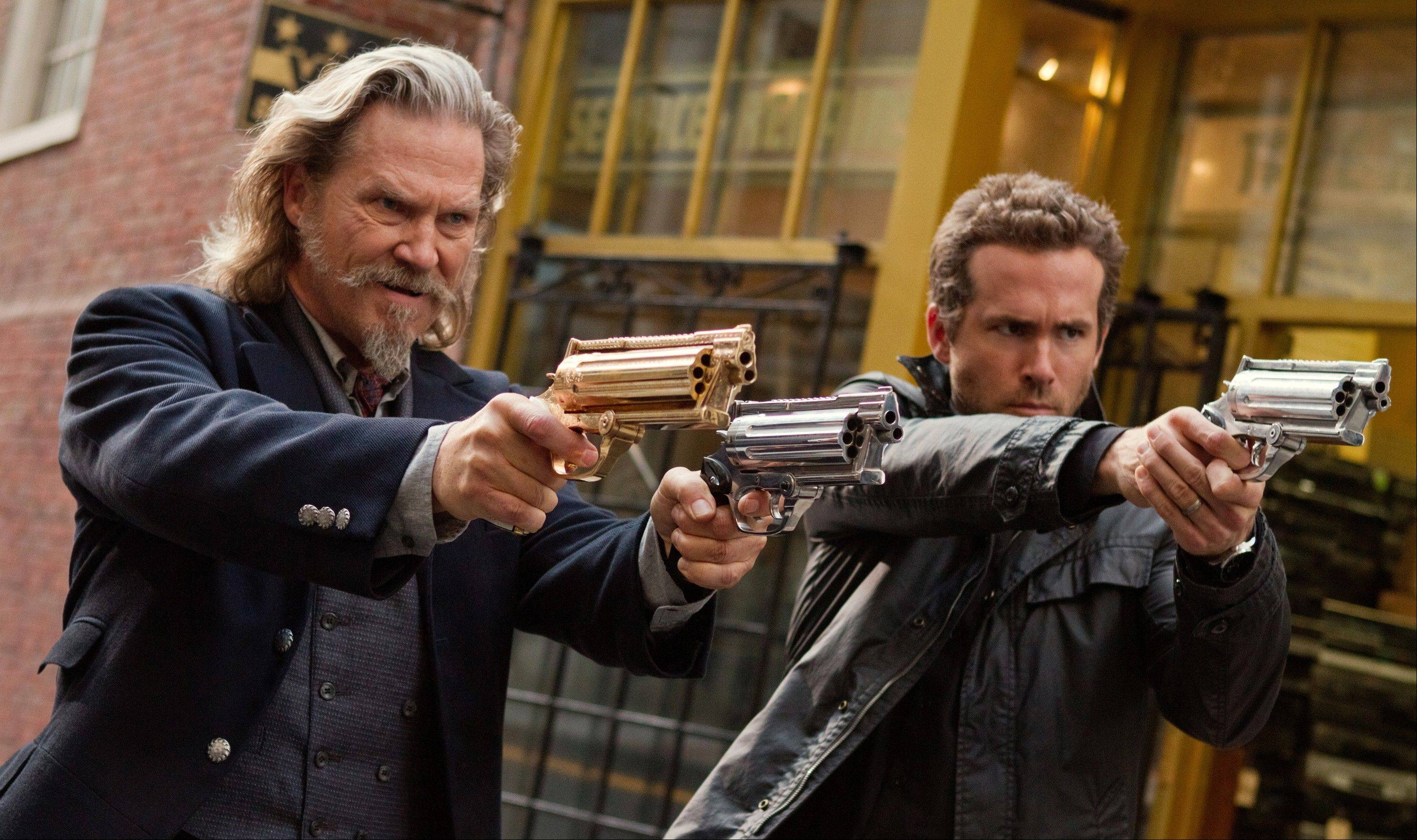 "Jeff Bridges, left, and Ryan Reynolds star in ""R.I.P.D."""