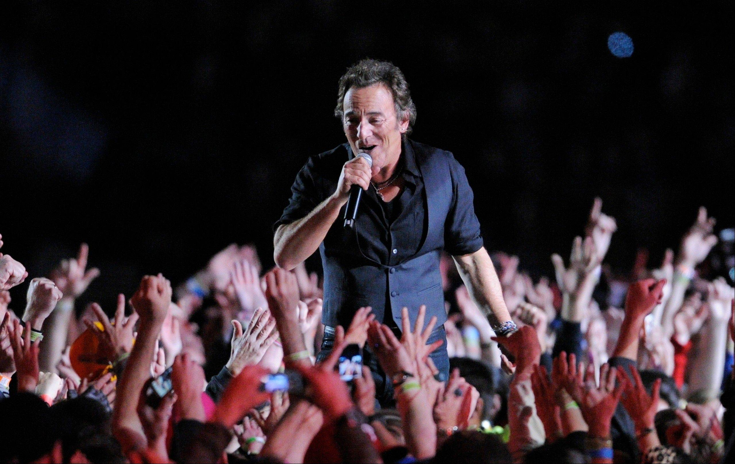 In this Feb. 1, 2009 file photo, Bruce Springsteen performs during halftime of the NFL Super Bowl XLIII football game between the Arizona Cardinals and the Pittsburgh Steelers in Tampa, Fla. This year's Super Bowl performer will Bruno Mars.