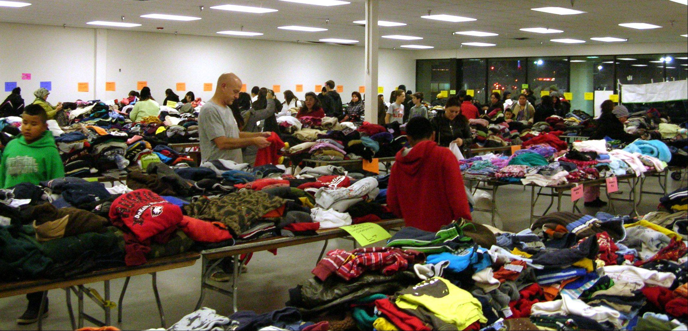Palatine Assisting Through Hope's Annual Day of Giving drew 970 people in need of winter clothing and outer wear for children. The event, operated by volunteers from area churches and high schools, has grown so big that it needed to be moved to a storefront donated by the owner of the Park Place Shopping Center in Palatine.