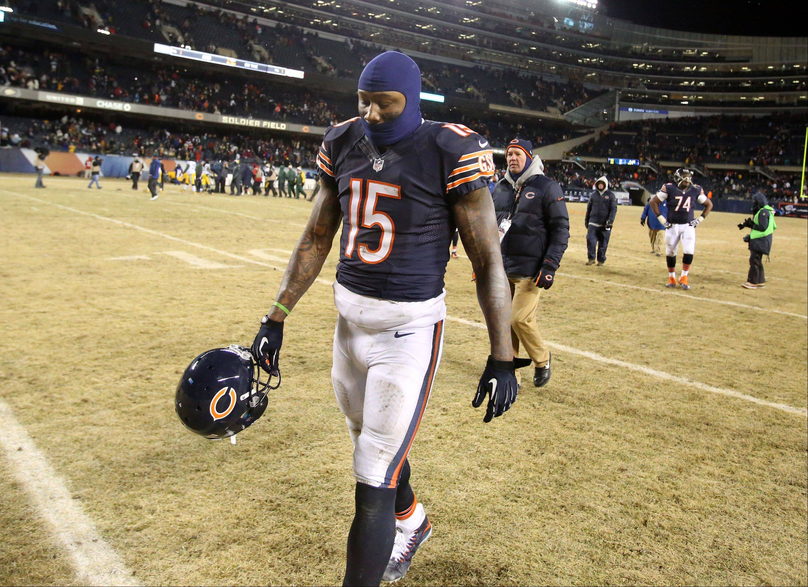 Bears wide receiver Brandon Marshall walks off the field after losing to the Green Bay Packers 33-28 on Sunday at Soldier Field in Chicago.