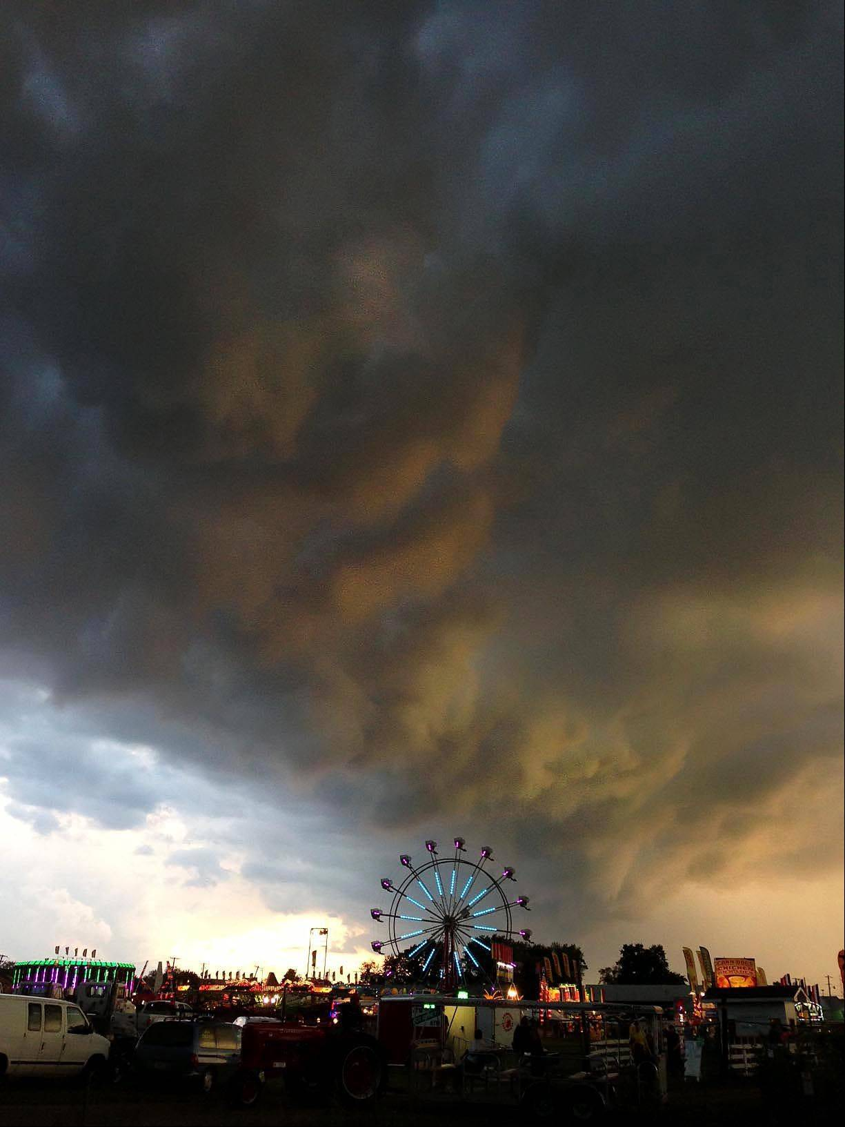 A thunderstorm rolls over the McHenry County Fair. The rain stopped the midway rides and the McHenry County Queen pageant for a short time.