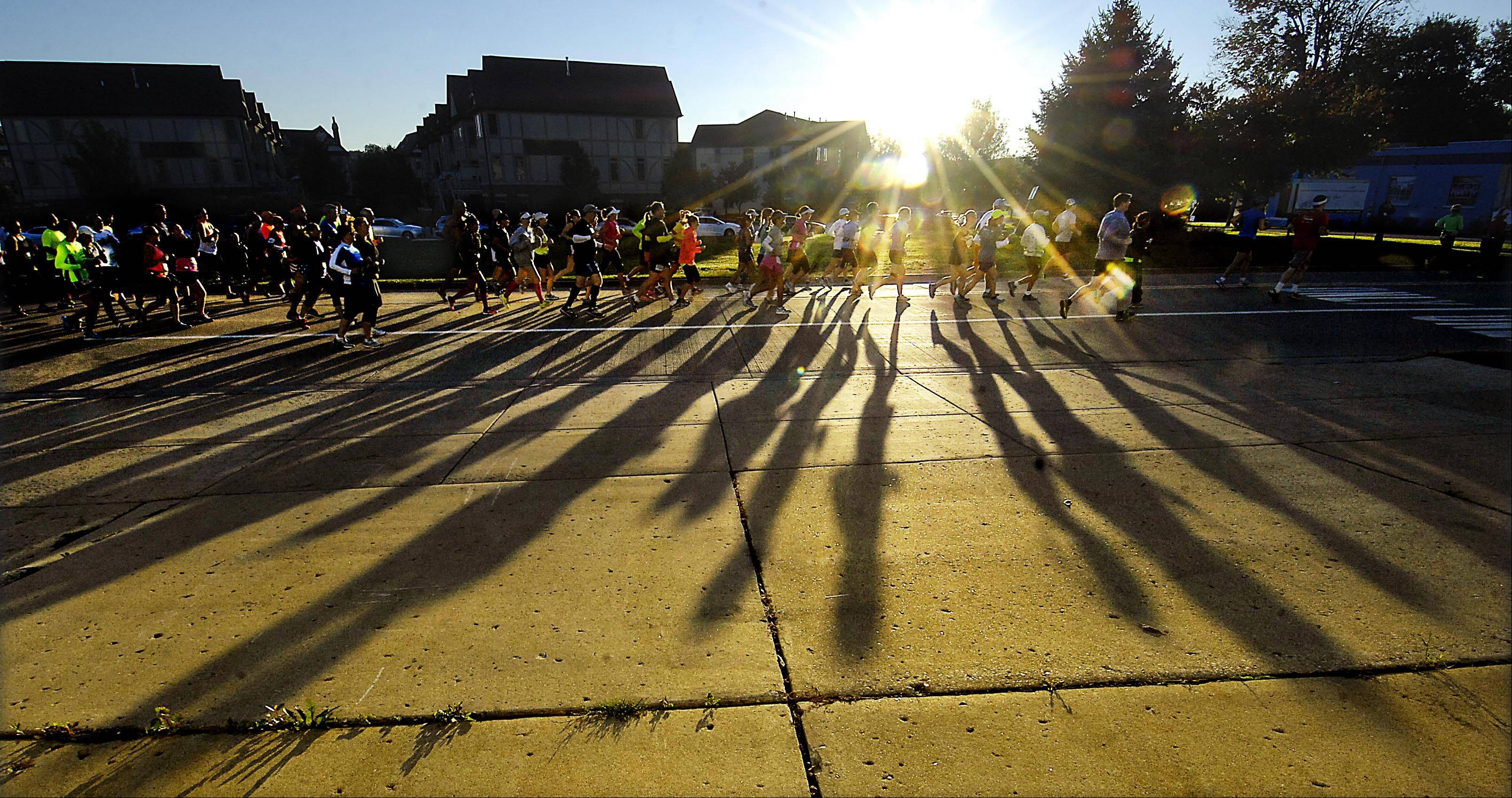Runners start at sunrise on First Street at the Fox Valley Marathon in St. Charles.