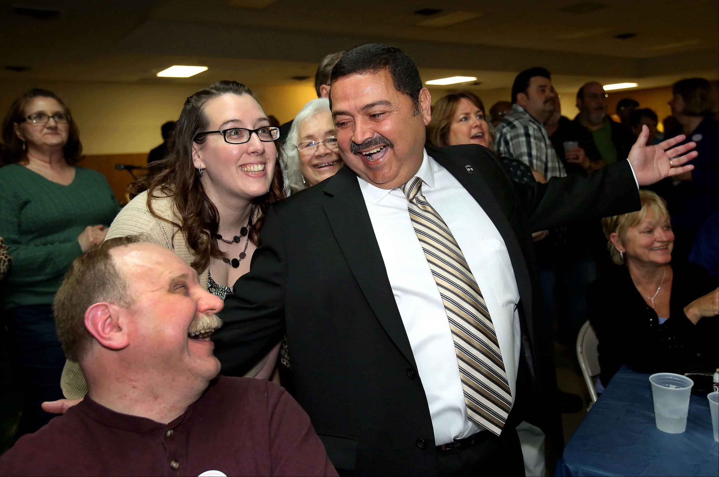 Ruben Pineda, mayoral candidate for West Chicago, right, celebrates his victory on Tuesday, April 9, 2013, in West Chicago with his campaign manager Melissa Birch, center and Gary Saake, left, candidate for District 94 Board of Education.