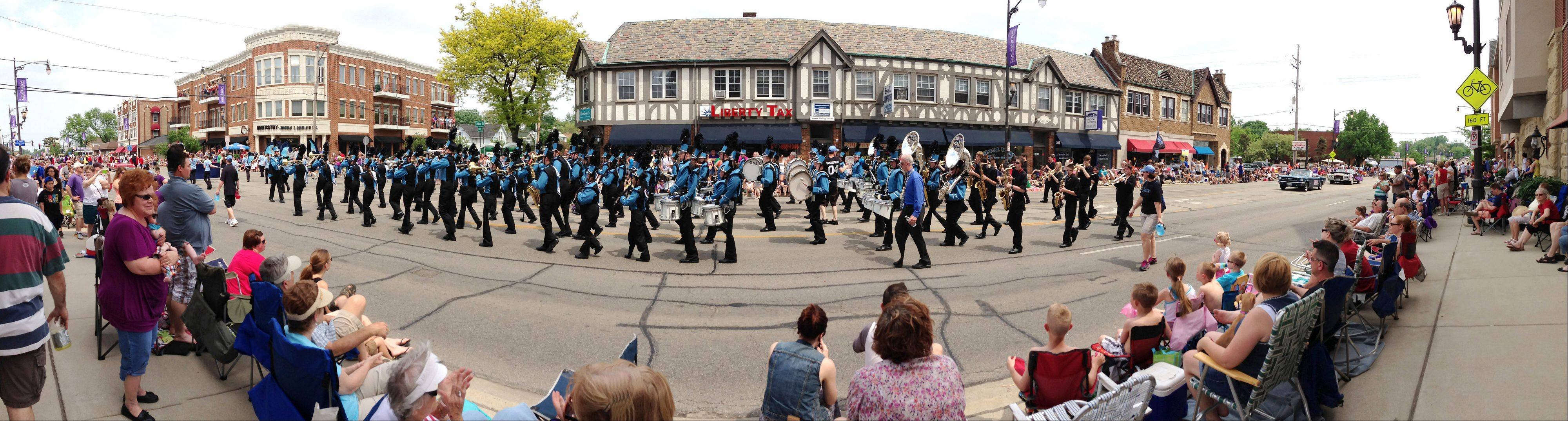 The Main Street parade! What would summer be without the marching bands on Main Street, hot weather, flags, and enthusiastic crowds lining the street? Events like this are popular with photographers sporting all sorts of cameras, including cellphone cameras. This photo of the Willowbrook High School marching band in Lombard's Lilac Parade was taken in the panorama mode with my iPhone 5 cellphone camera. When used like this, it bends reality a little, along with the street, but I think it is an interesting effect.