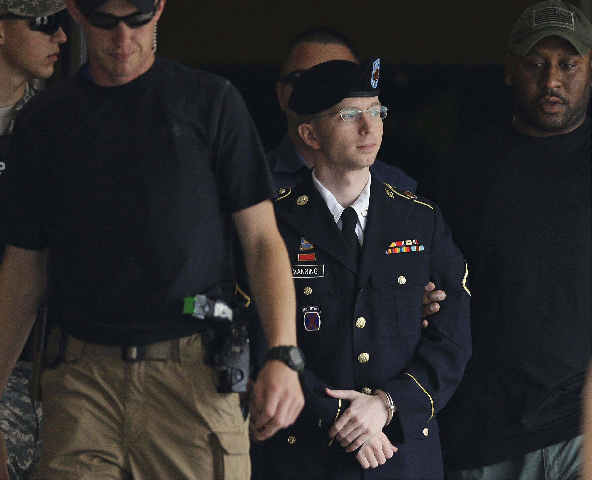 Army Pfc. Bradley Manning is escorted out of a courthouse in Fort Meade, Md., Tuesday, July 30, 2013, after receiving a verdict in his court martial. Manning was acquitted of aiding the enemy � the most serious charge he faced � but was convicted of espionage, theft and other charges, more than three years after he revealed secrets to WikiLeaks.