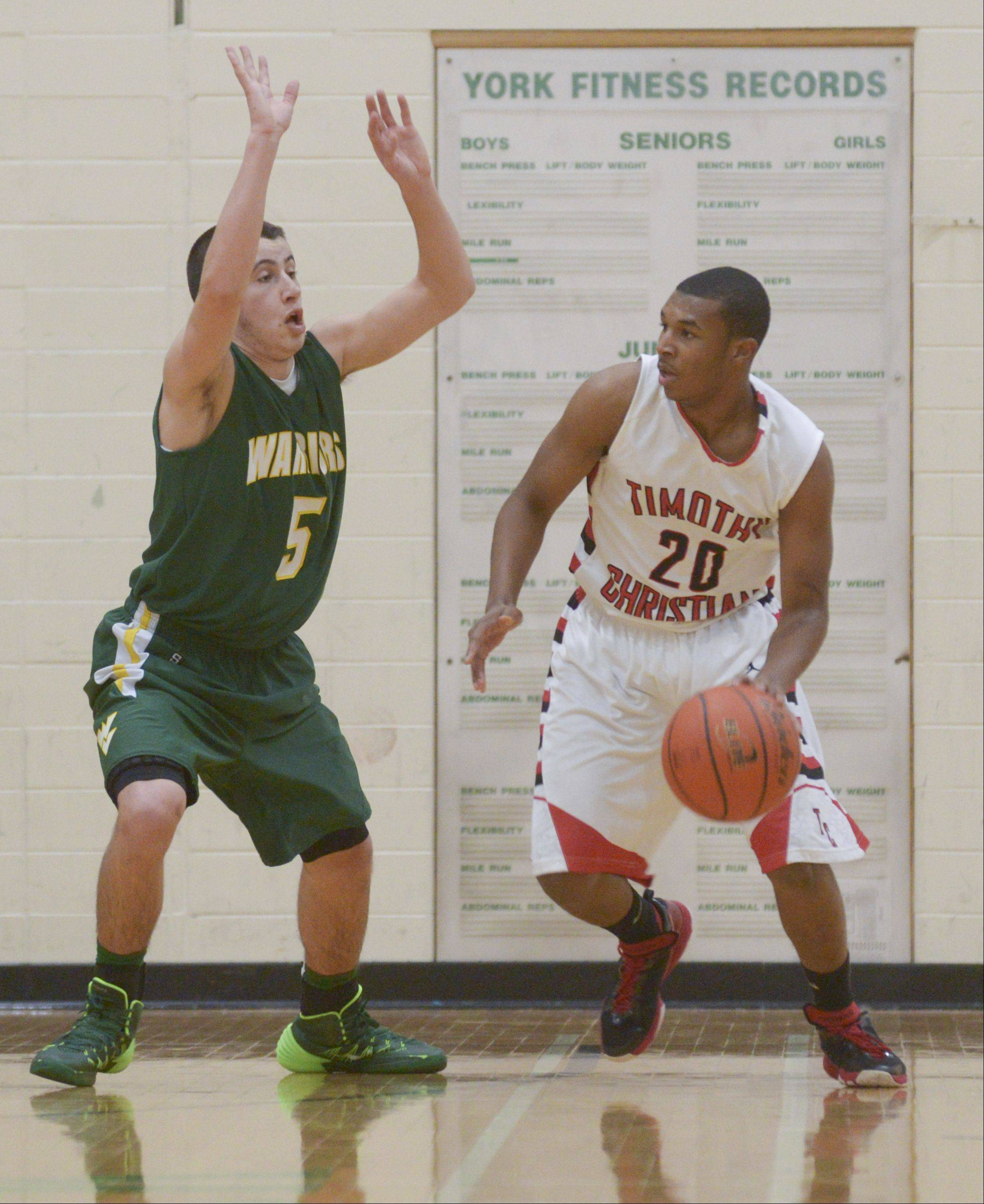 Images from the Waubonsie Valley vs. Timothy Christian boys basketball game on Monday, Dec. 30, 2013.