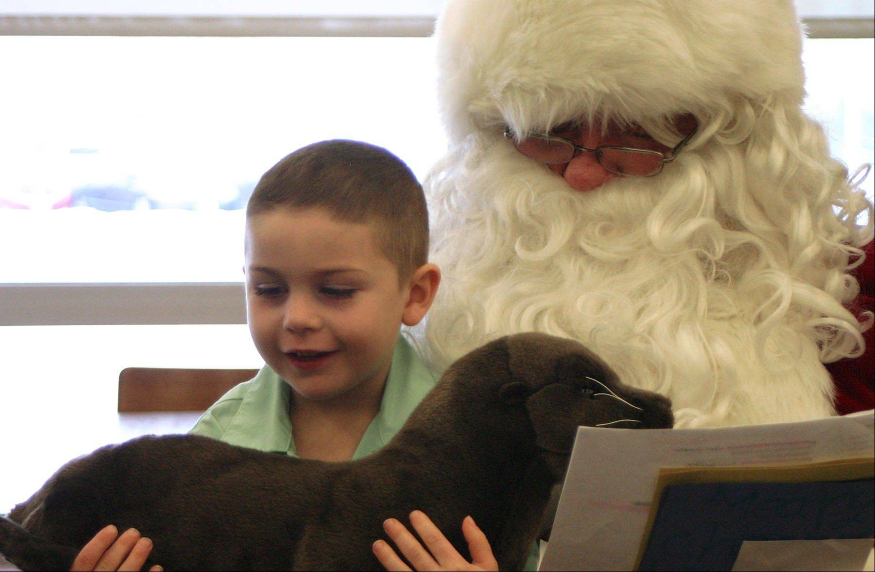 "When asked what he wanted from Santa Claus, Mooseheart kindergartner Jonathan Lyon said ""a seal."" During Santa's visit on Dec. 19, Lyon received a plush seal, which was immediately appreciated."