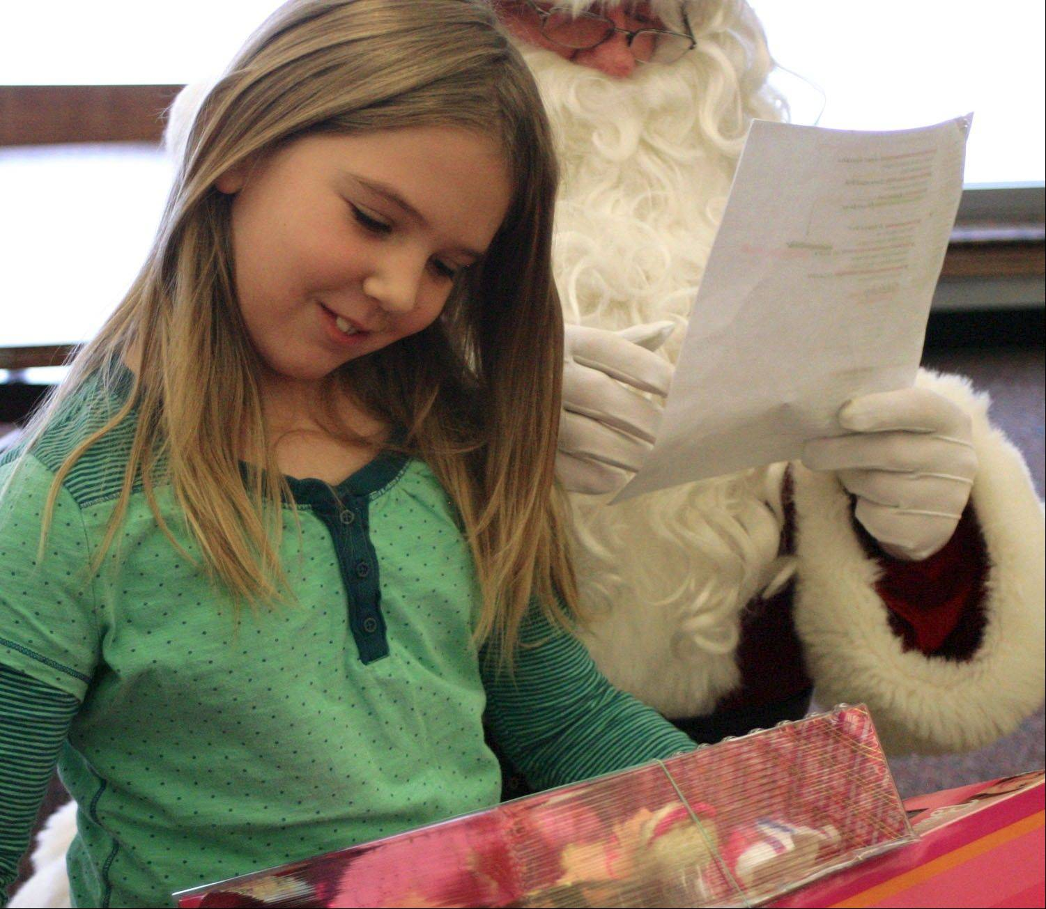 All Mooseheart elementary schoolchildren were on Santa's list for gifts, including second-grader Ashlyn Cranfield, who has been on campus for one month.