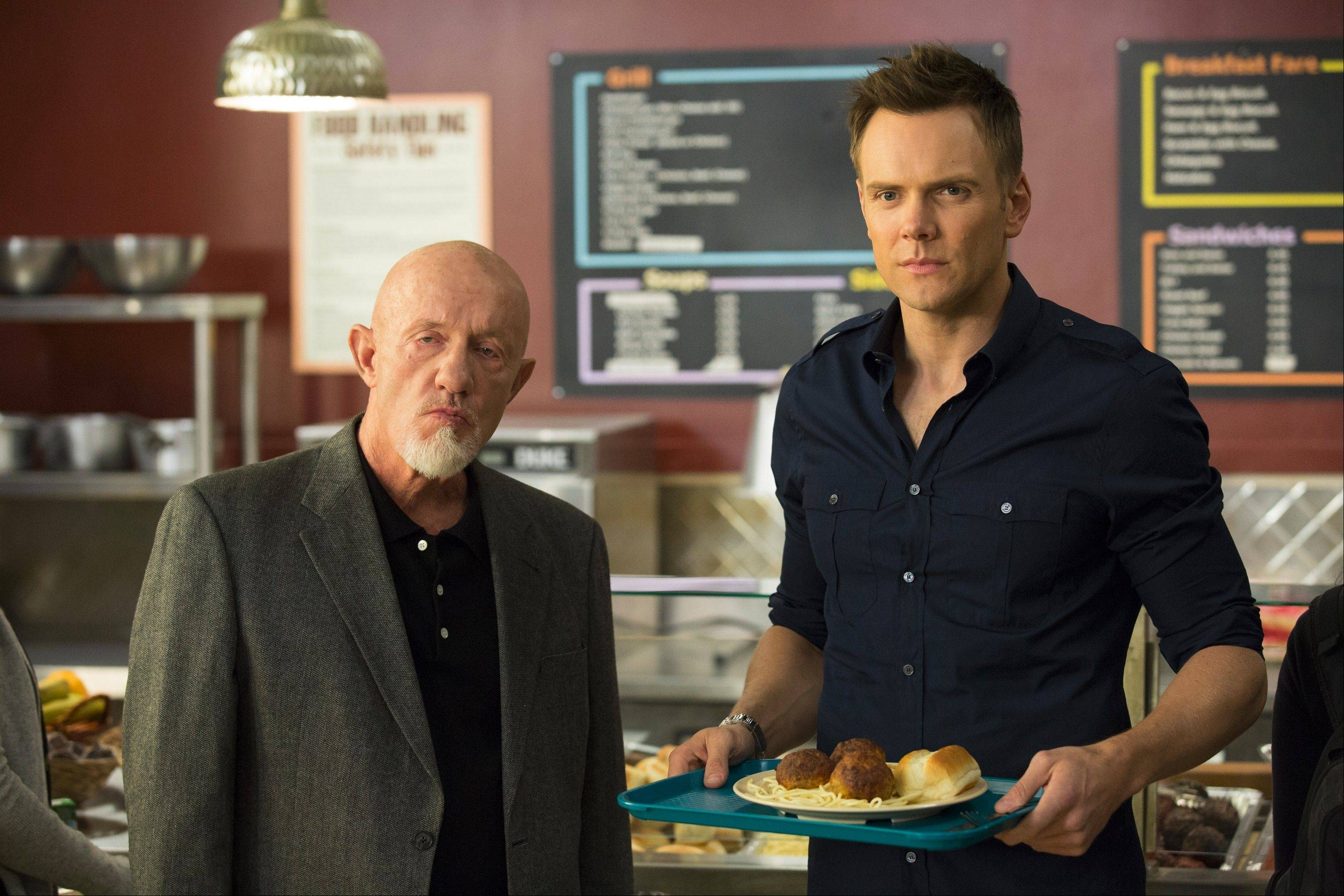 "Jonathan Banks, left, joins the ""Community"" cast as a professor and Joel McHale heads back to school — despite his character having graduated — when the NBC sitcom returns on Jan. 2"
