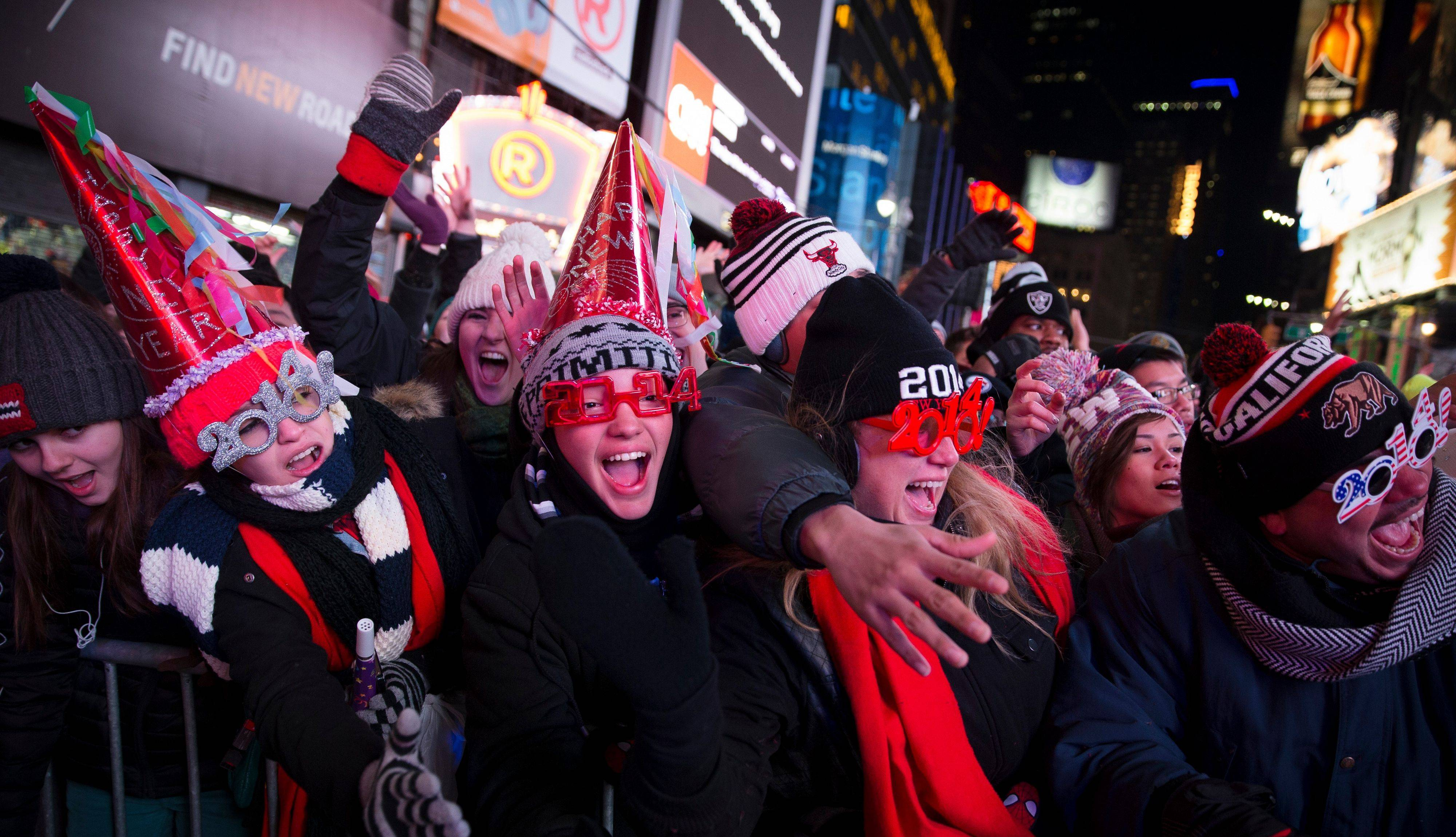 Revelers cheer as they wait for midnight during the New Year's Eve celebrations in Times Square, Tuesday.
