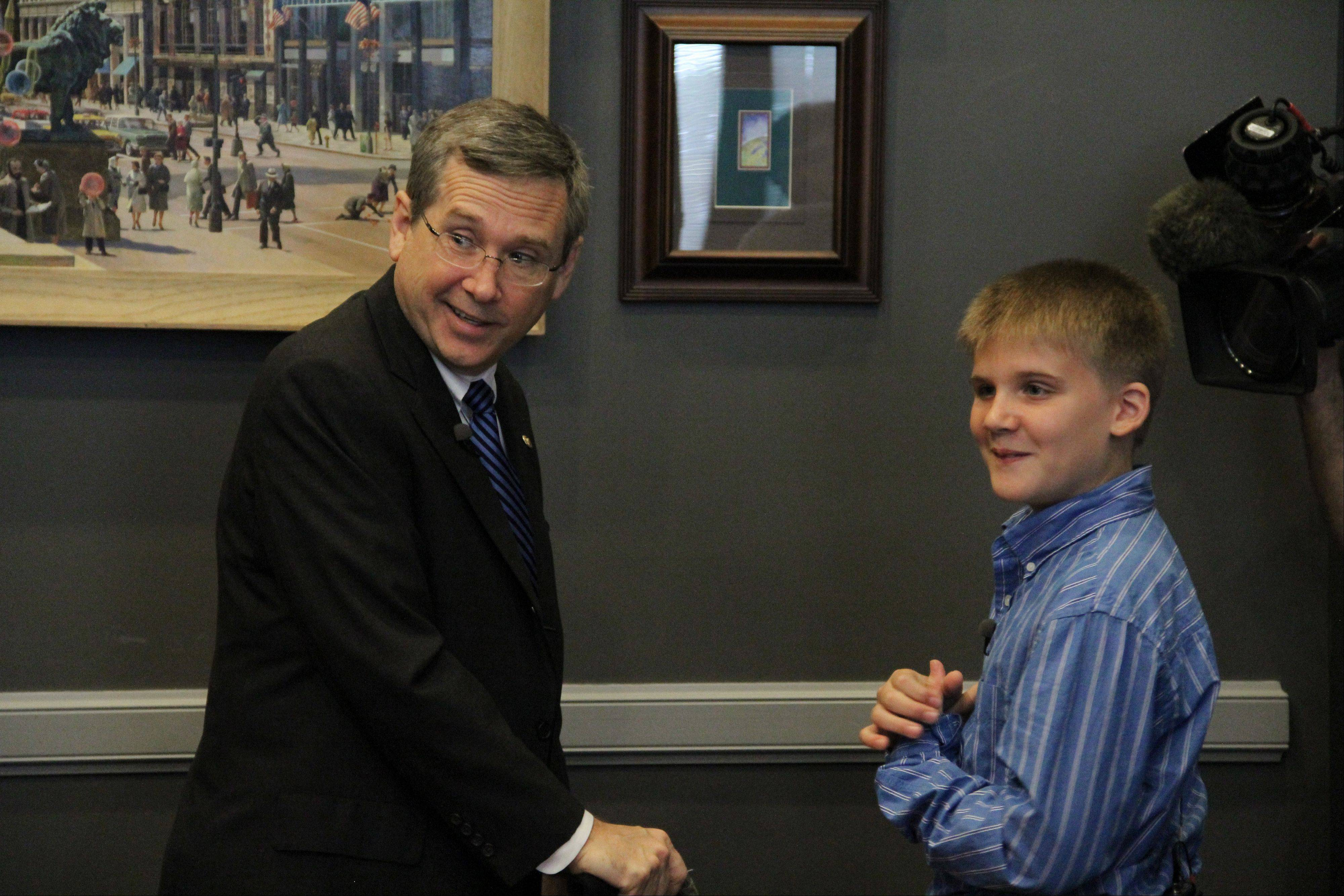 "U.S. Sen. Mark Kirk visits with Jackson Cunningham in his office on Aug. 8 in Washington. Kirk calls Jackson, a fellow stroke victim, a ""loyal and motivating force."""