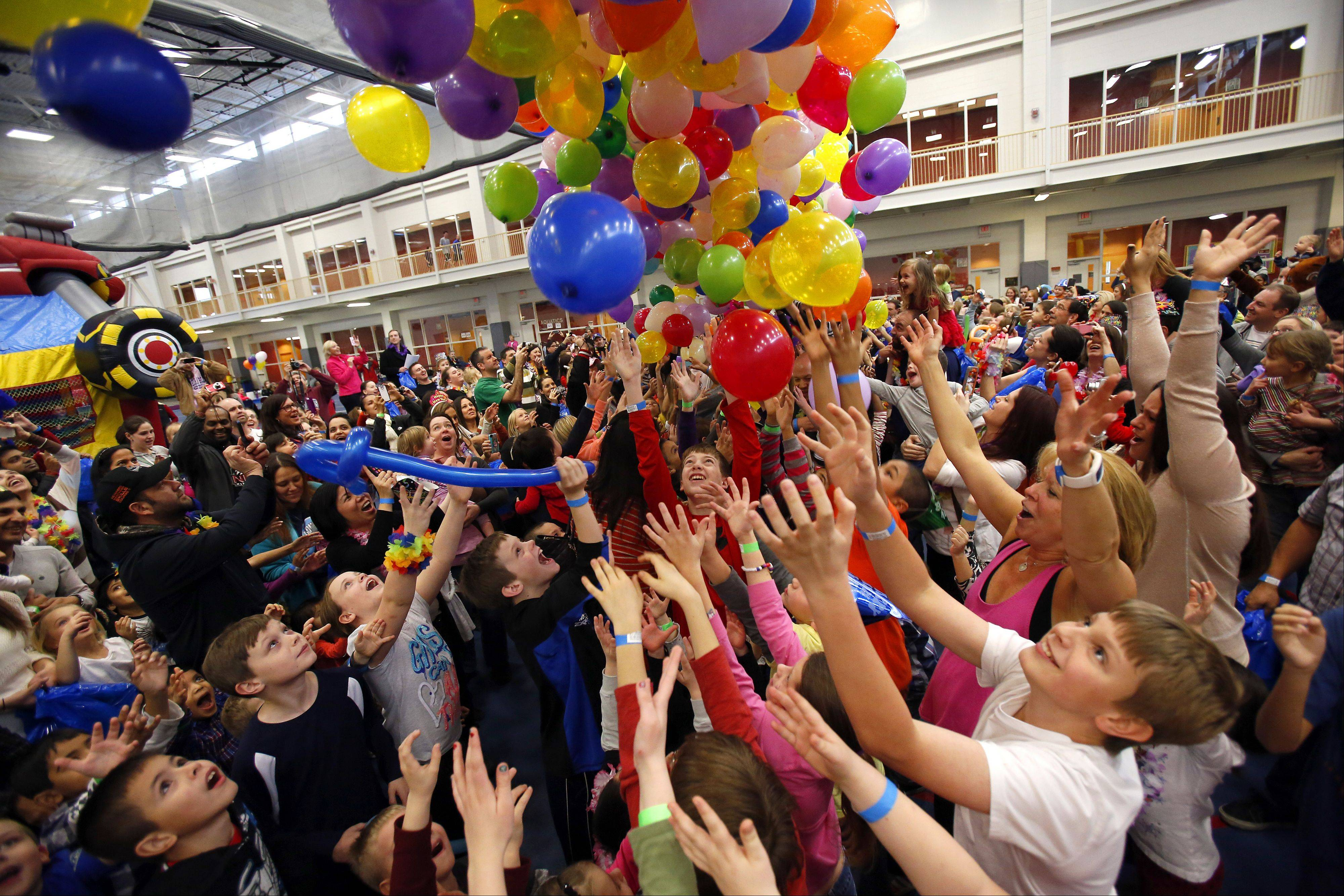 The countdown to noon ended in a balloon drop during the Family New Year�s Eve Party Tuesday at Vaughan Athletic Center in Aurora.