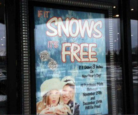 A sign in the window of PK Bennett Jewelry in Mundelein advertises their snow promotion. If more than 3 inches falls, customers who made purchases between Black Friday and Christmas Eve will get the items free.