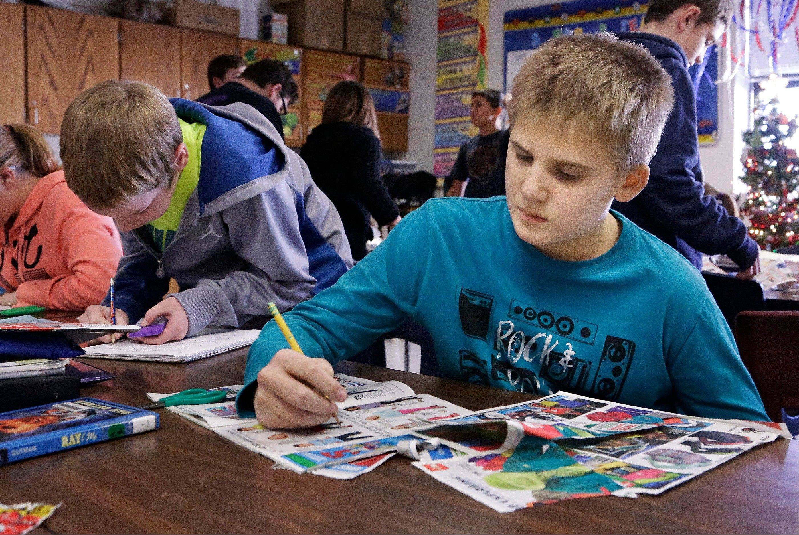 Jackson Cunningham, 11, works on a math project with his classmates at Oakwood Grade School in Oakwood, Ill. Cunningham suffered a stroke in 2011 after an afternoon basketball game, and much of the left side of his body became paralyzed. Resilience and determination have been source of inspiration to U.S. Sen. Mark Kirk, who Cunningham reached out to when Kirk suffered a stroke of his own a year later.