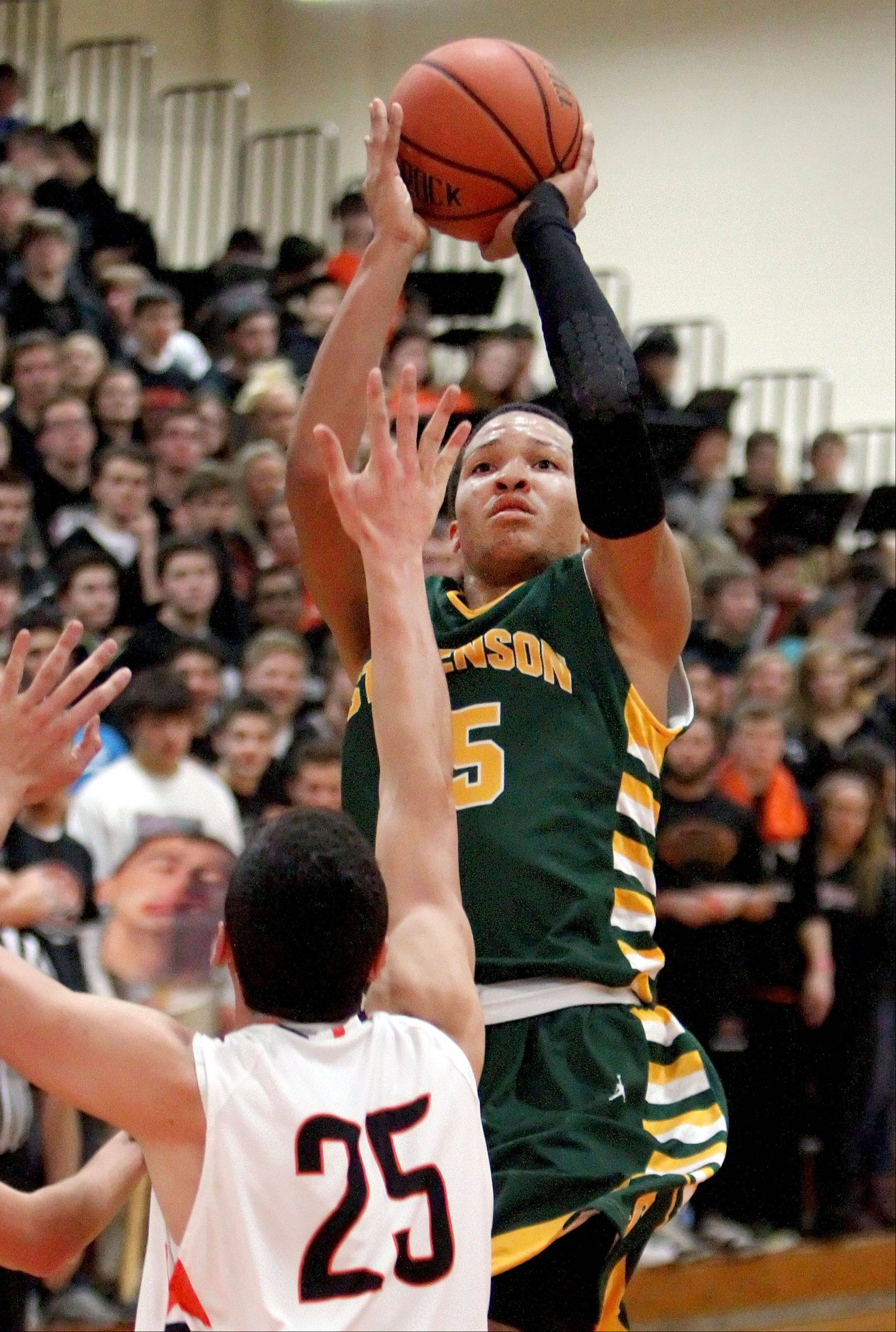 Stevenson's Jalen Brunson, here shooting against Libertyville earlier this season, helped the Patriots become the first Lake County team to win Proviso West's boys basketball tournament Tuesday. Brunson finished with a game-high 23 points as Stevenson topped Morgan Park 67-55.