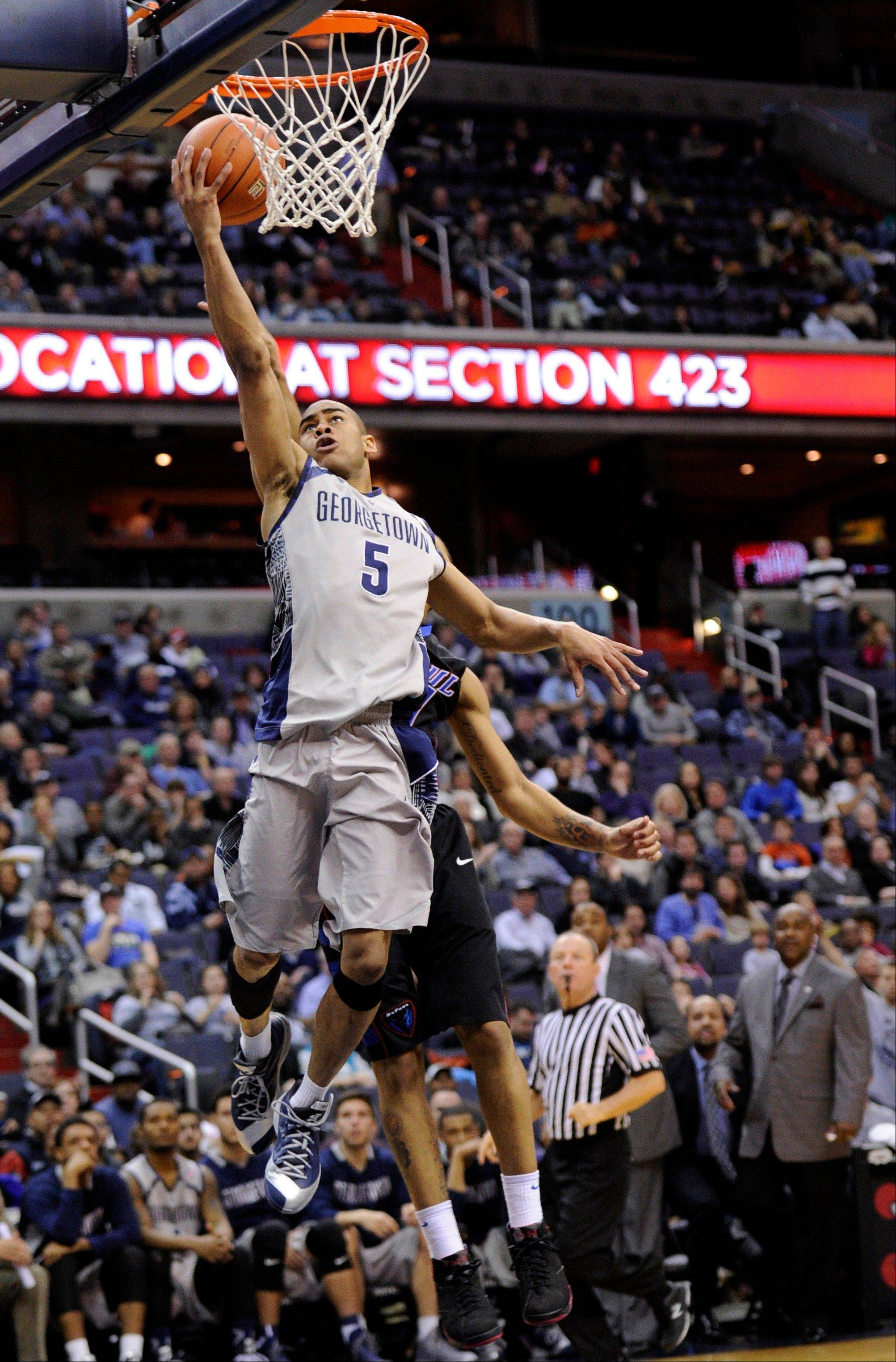 Georgetown guard Markel Starks (5) goes to the basket against DePaul guard Brandon Young, back, during the second half of an NCAA college basketball game, Tuesday, Dec. 31, 2013, in Washington. Georgetown won 61-54. (AP Photo/Nick Wass)