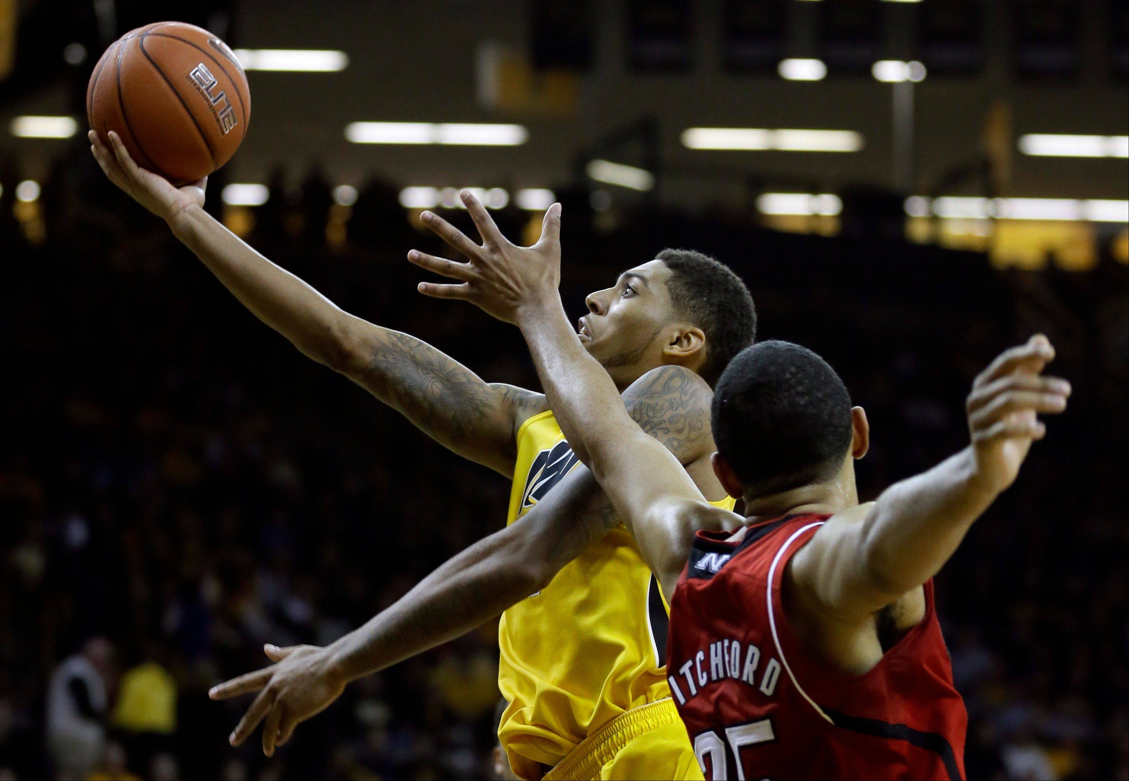 Iowa guard Devyn Marble drives to the basket past Nebraska forward Walter Pitchford during the second half of Tuesday�s game in Iowa City.