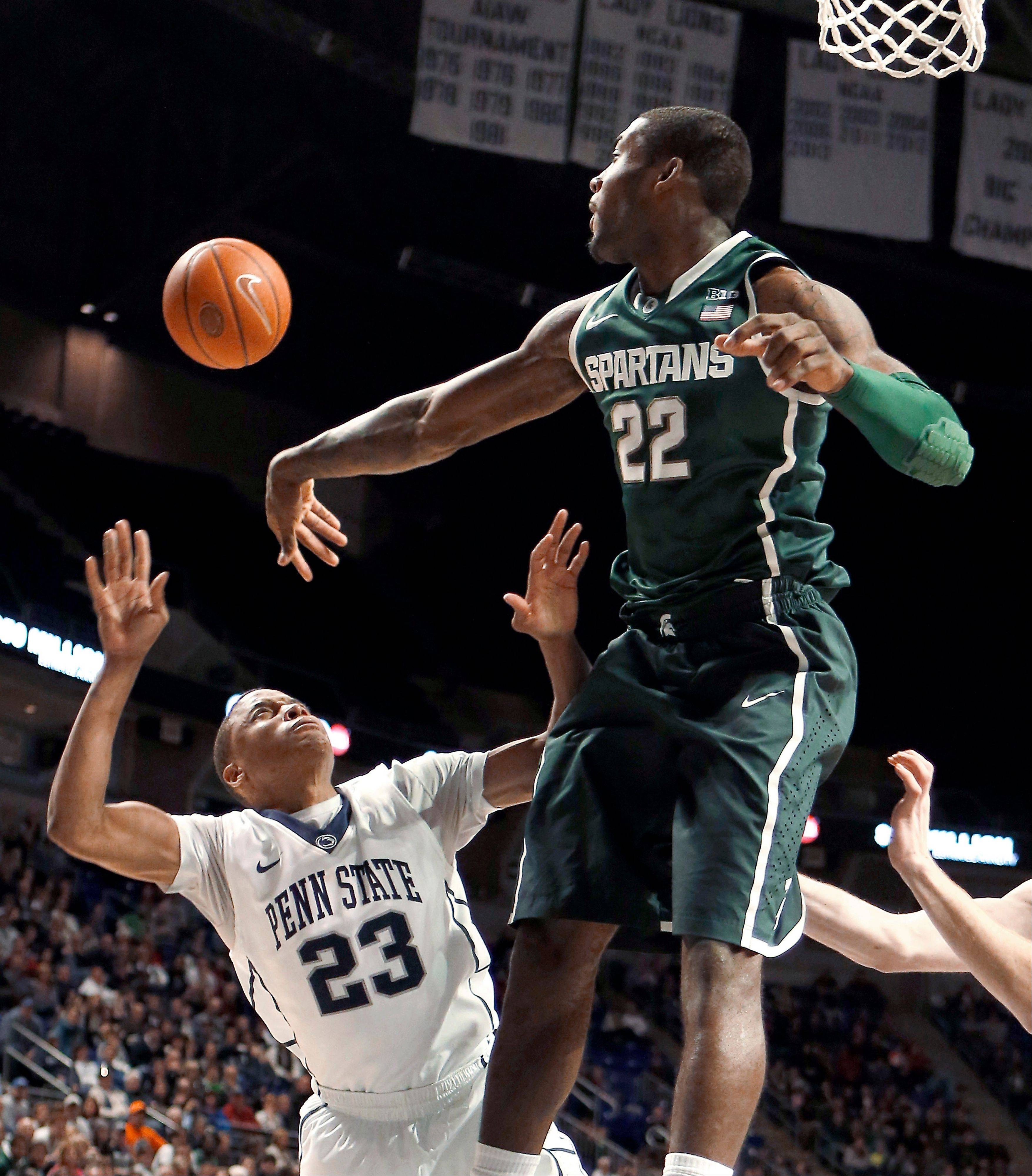 Michigan State's Branden Dawson blocks a shot by Penn State's Tim Frazier during the second half of Tuesday's game in State College, Pa.