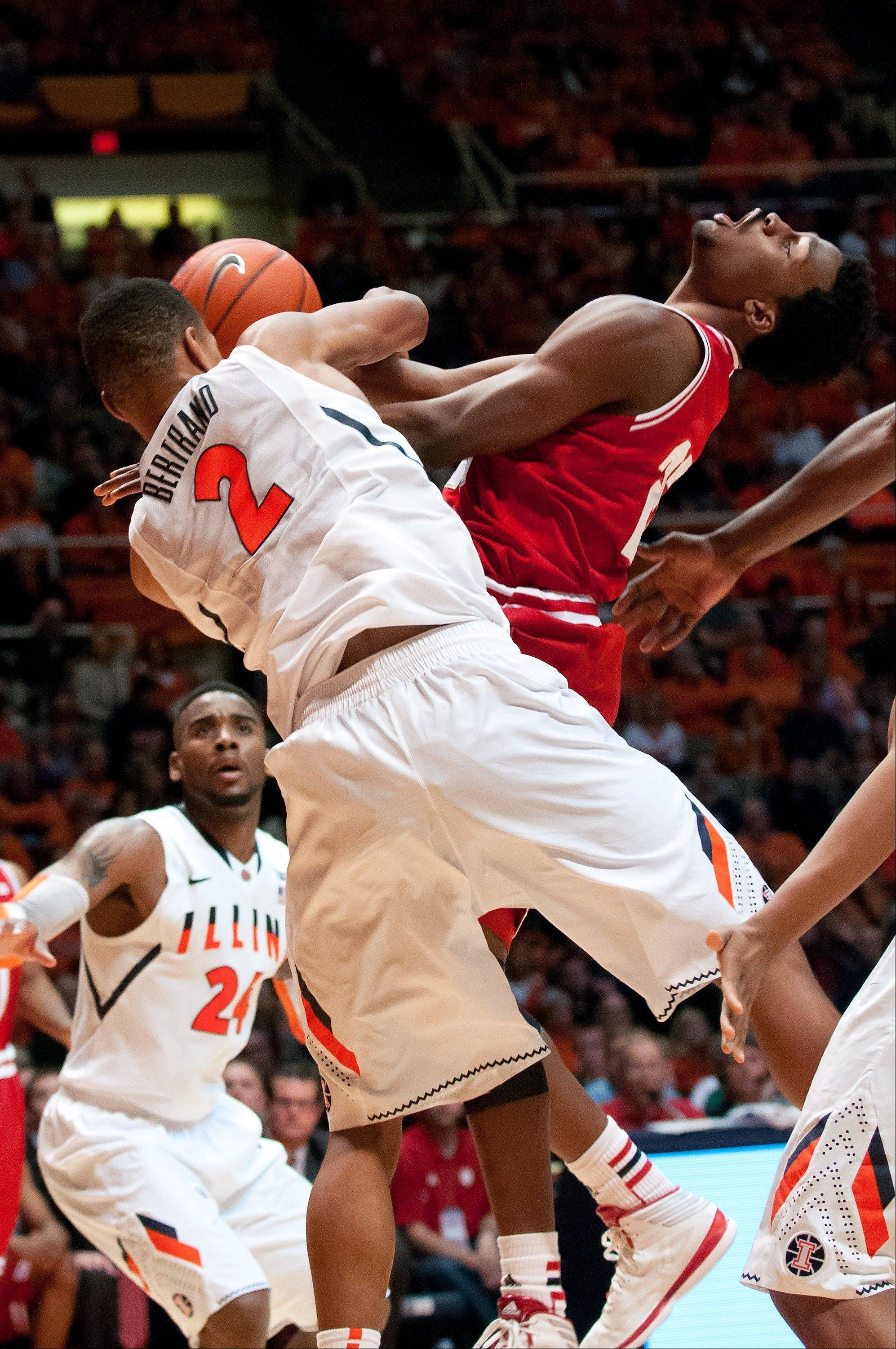 Indiana guard Stanford Robinson is fouled by Illinois guard Joseph Bertrand during the second half of Tuesday�s game in Champaign, Ill.