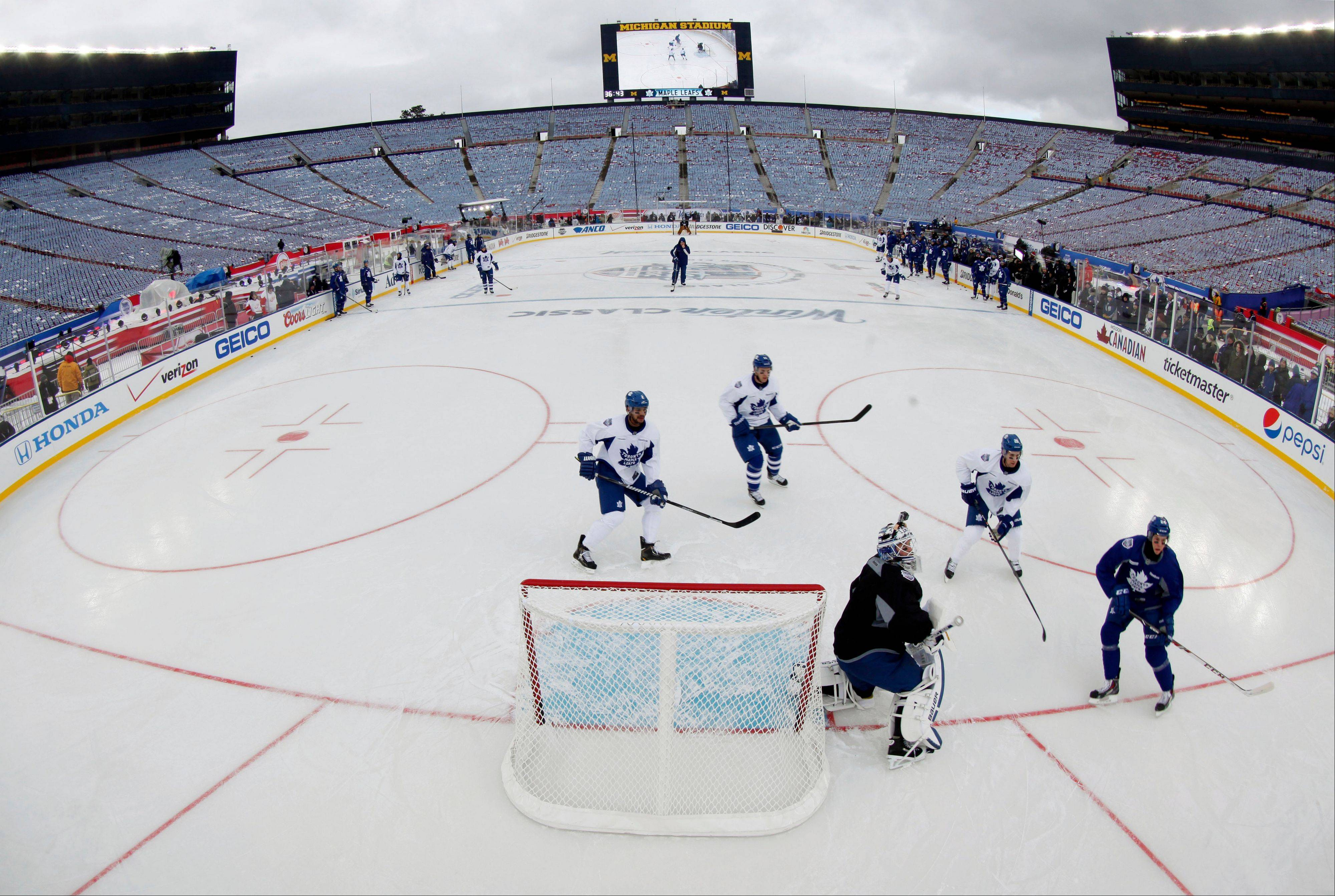 Toronto Maple Leafs players practice Tuesday on the outdoor rink for Wednesday's Winter Classic against the Detroit Red Wings at Michigan Stadium in Ann Arbor.