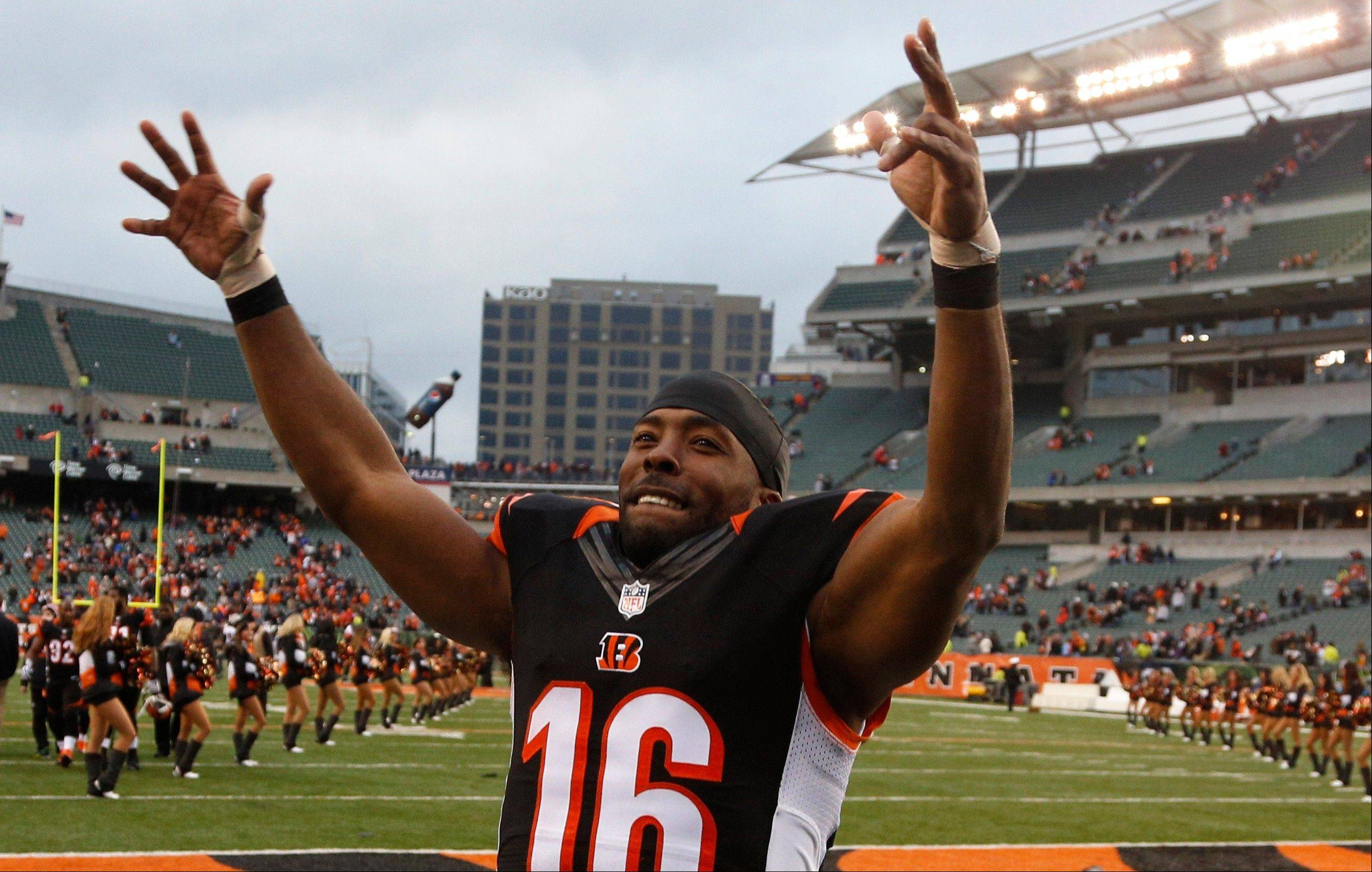 Wide receiver Andrew Hawkins celebrates after the Bengals defeated the Baltimore Ravens 34-17 in Sunday�s game in Cincinnati.