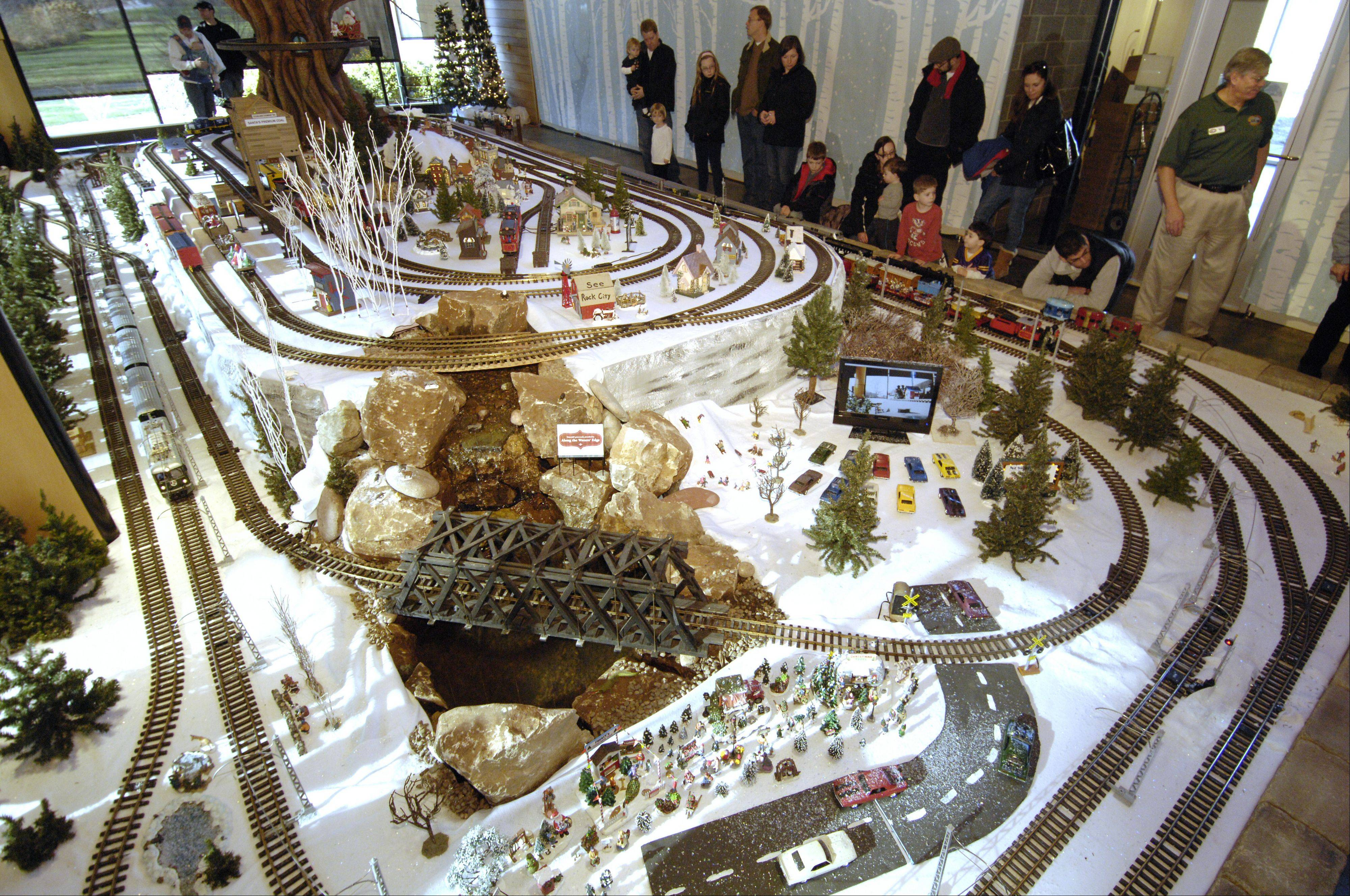 See a large model train run through a winter wonderland scene at the 12th annual Enchanted Railroad at the Morton Arboretum in Lisle.