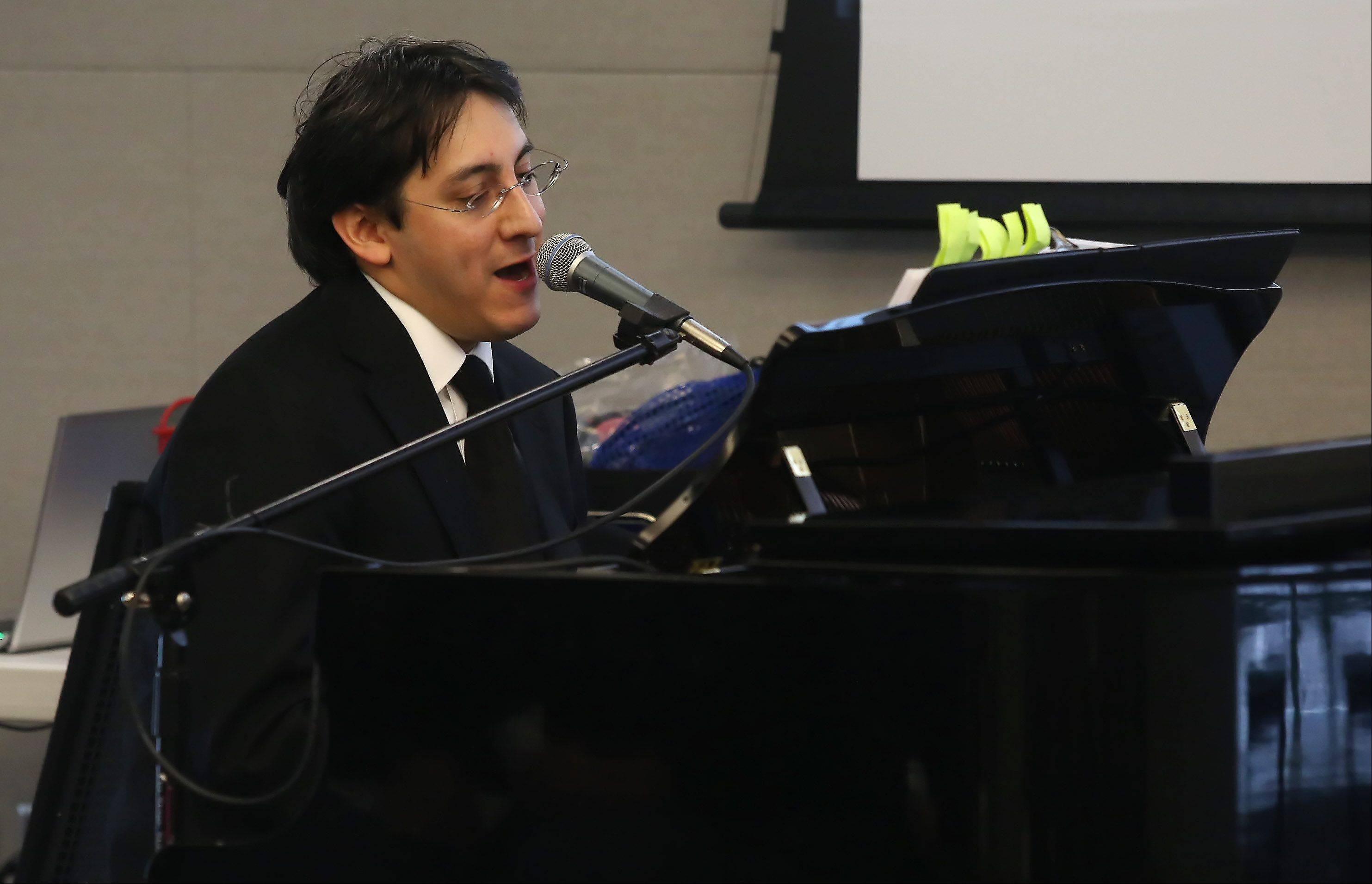 Musician and historian Jose Sandoval of Mount Prospect shares stories and songs during The Spirit of Motown program at the Vernon Area Public Library in Lincolnshire on Sunday. Sandoval played piano as he explored the story of Motown, the record label and sound that bridged the racial divide of the 60s.