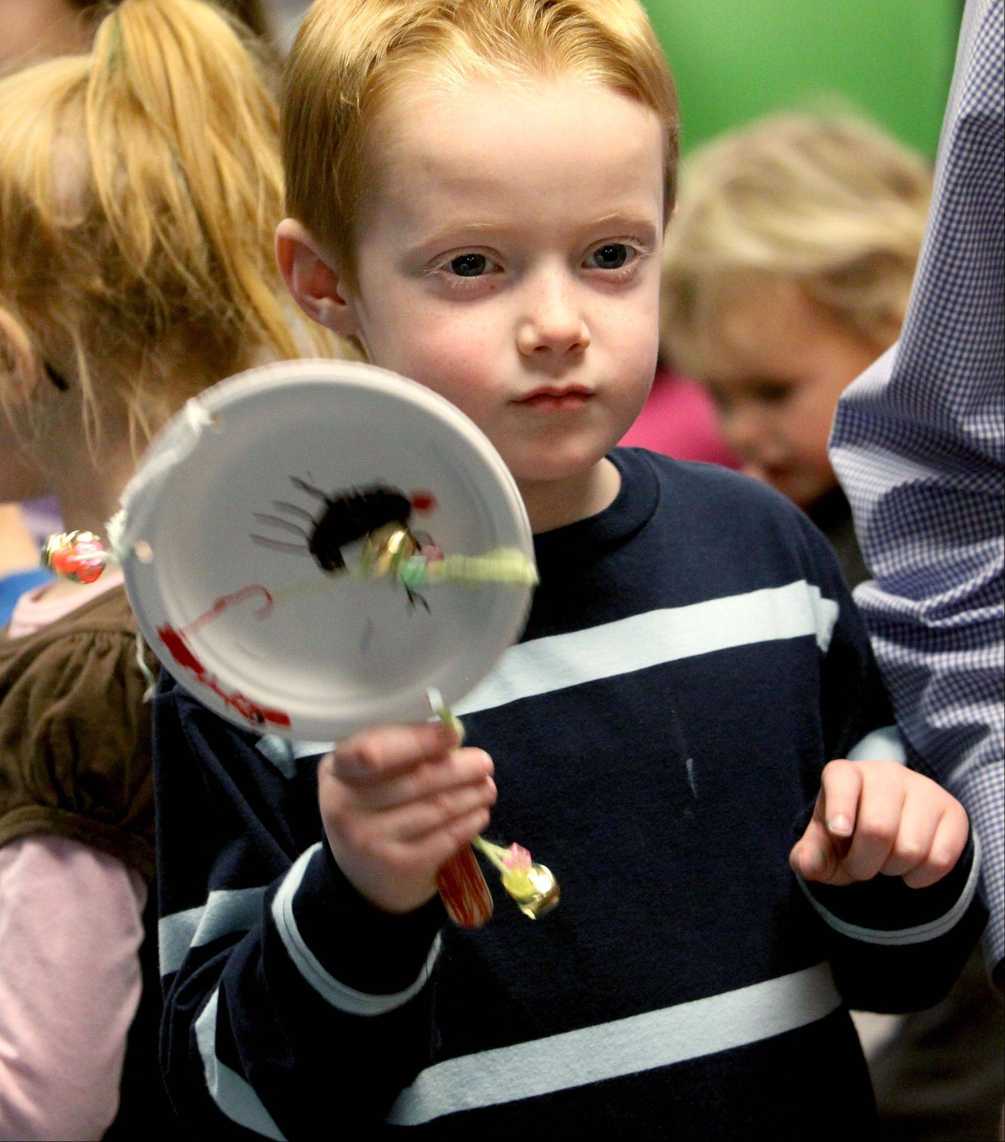 Colin Brady, 5, of Naperville, shakes a homemade noisemaker after the countdown to noon at the 12th annual Bubble Bash at the DuPage Children's Museum in Naperville.