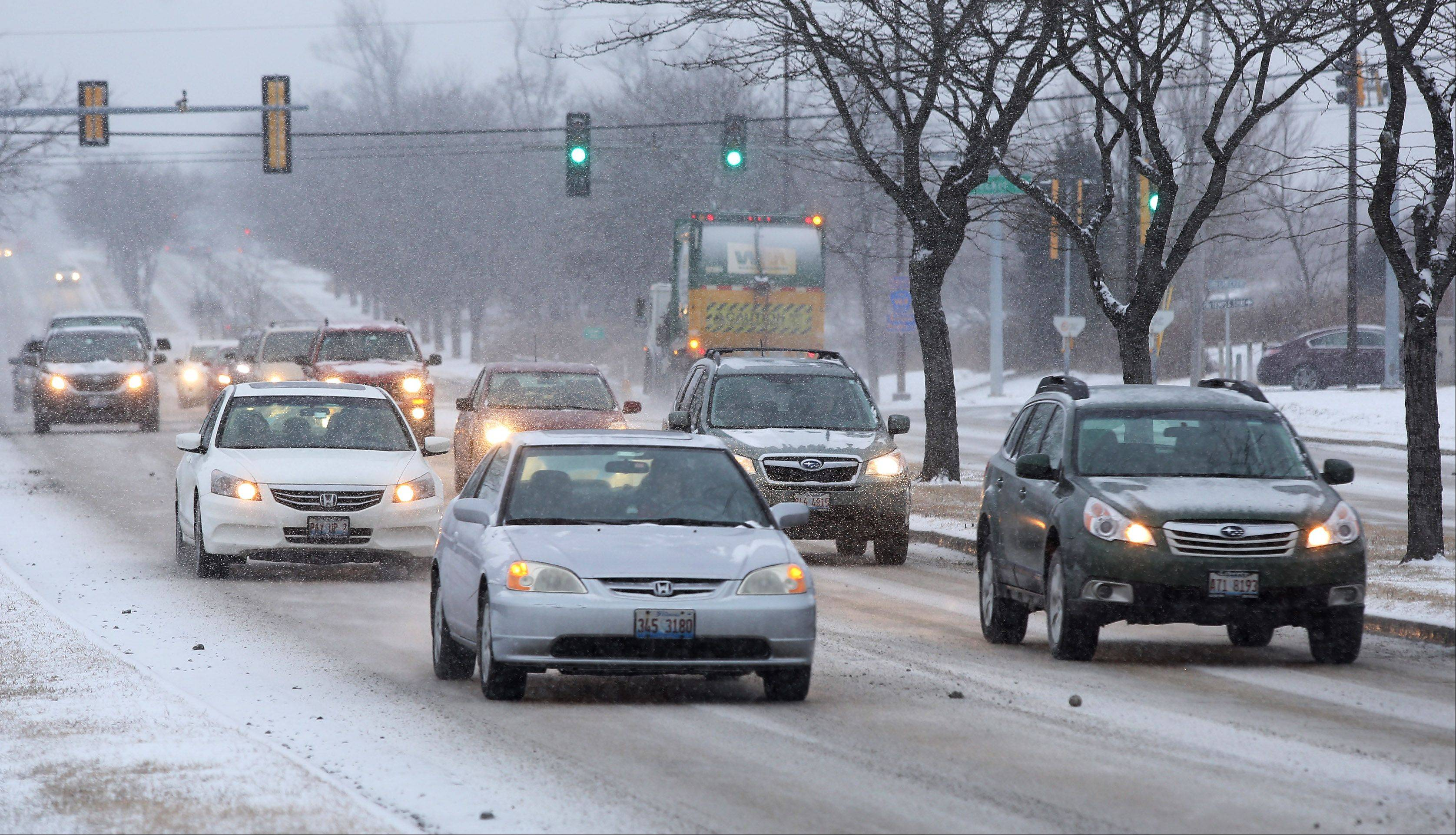 Snow started falling Tuesday just in time to slow down rush hour traffic along Arlington Heights Road in Buffalo Grove.