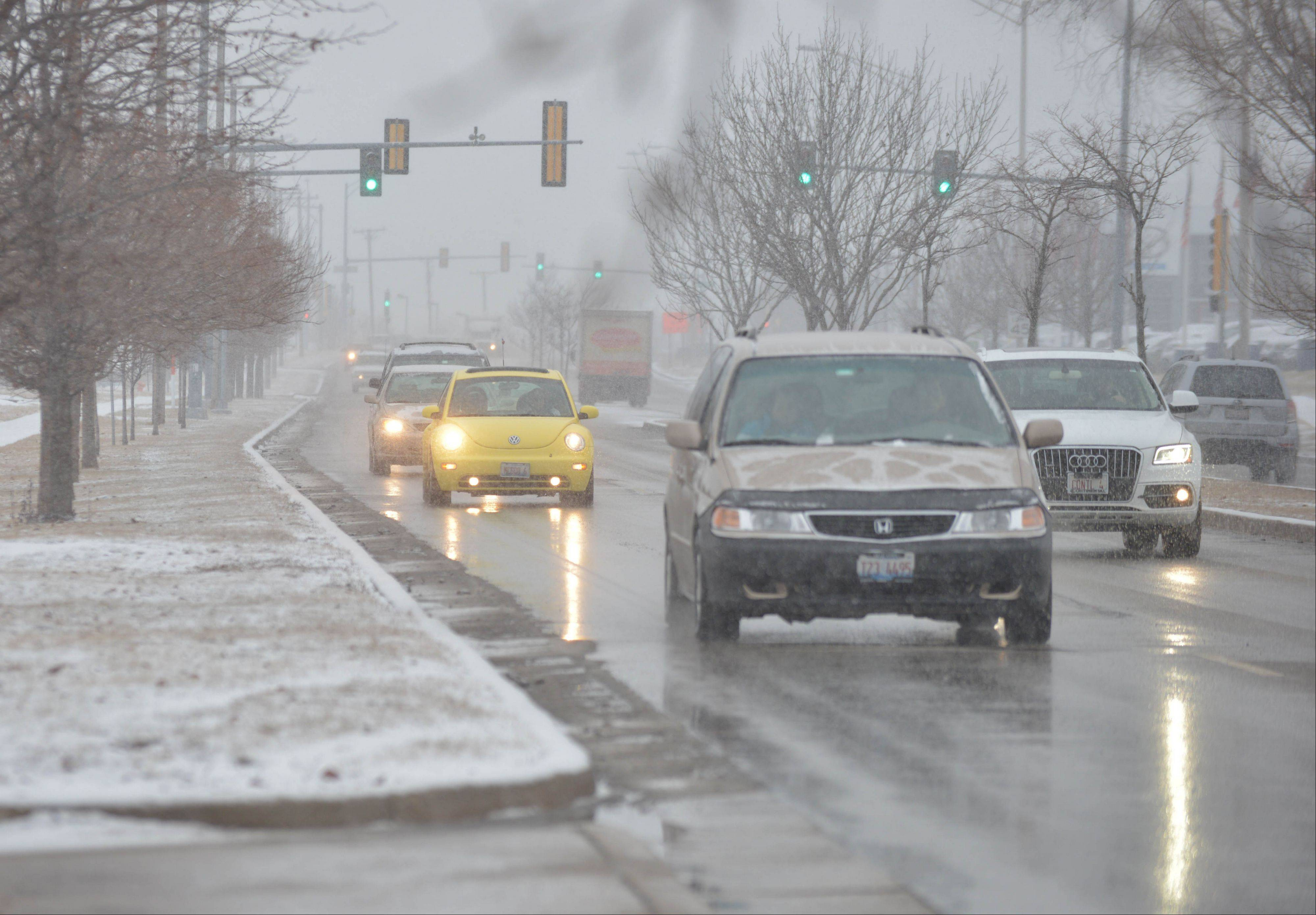 Vehicles proceed with caution along Aurora Avenue in Naperville late Tuesday afternoon. Our area is expected to receive between 3 and 6 inches of snow by Wednesday evening.