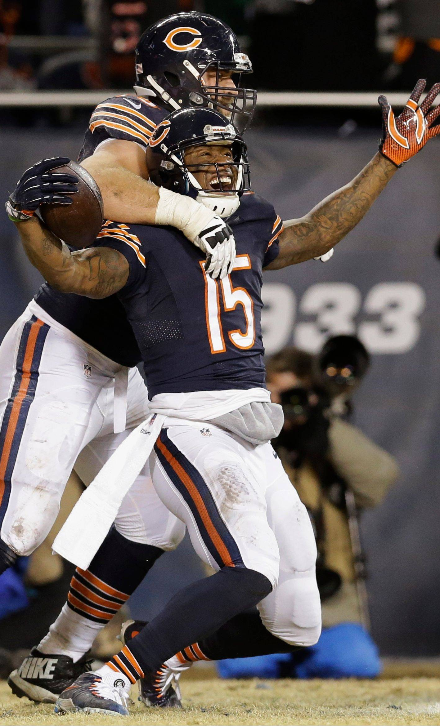 Brandon Marshall celebrates his touchdown reception with offensive guard Kyle Long during the second half of the Bears' loss to Green Bay on Sunday. Marshall and Alshon Jeffery combined for a team-record 2,716 receiving yards this season.