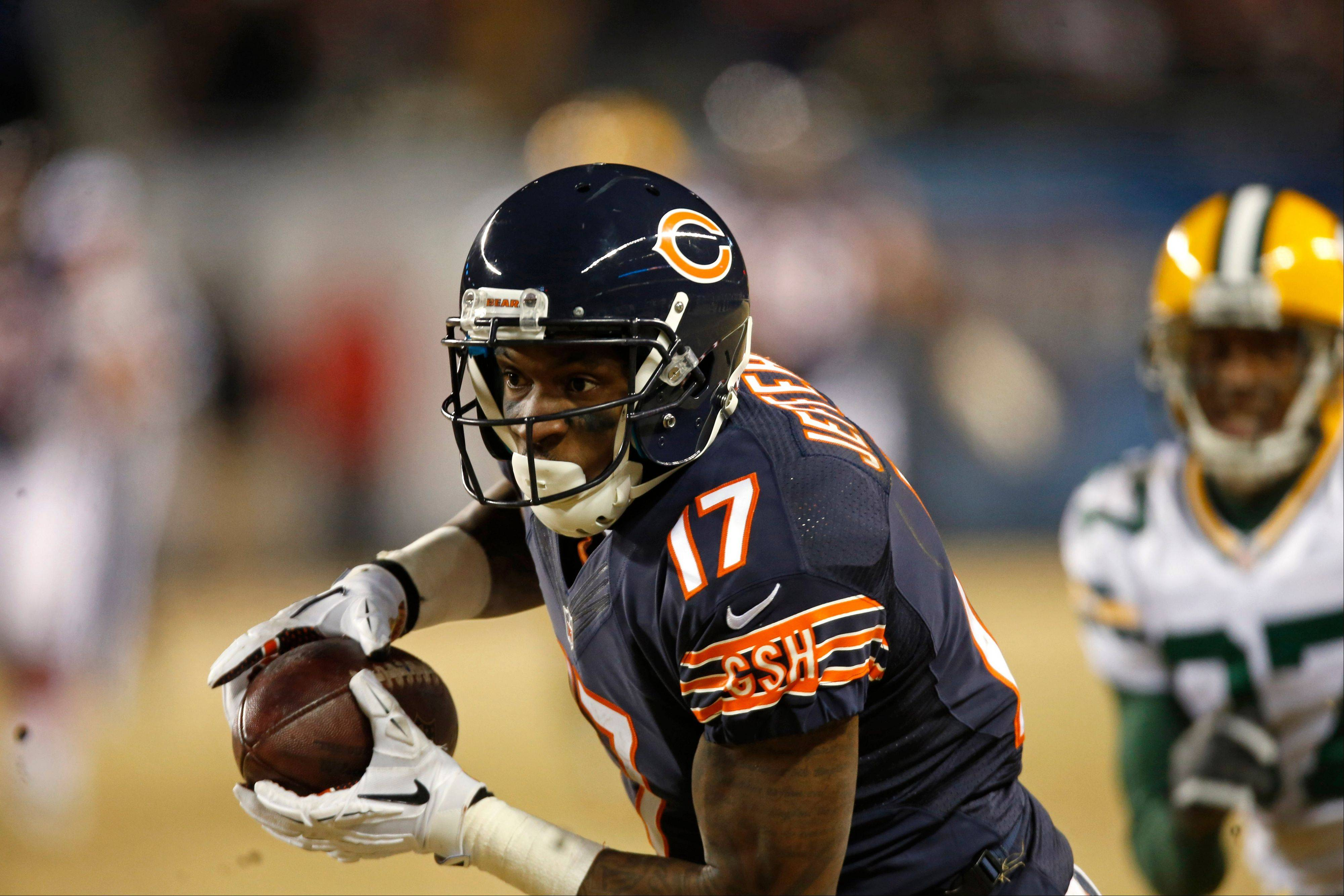 Bears wide receiver Alshon Jeffery (17) runs after making a catch against the Green Bay Packers during the second half of an NFL football game on Sunday, Dec. 29, 2013, in Chicago.