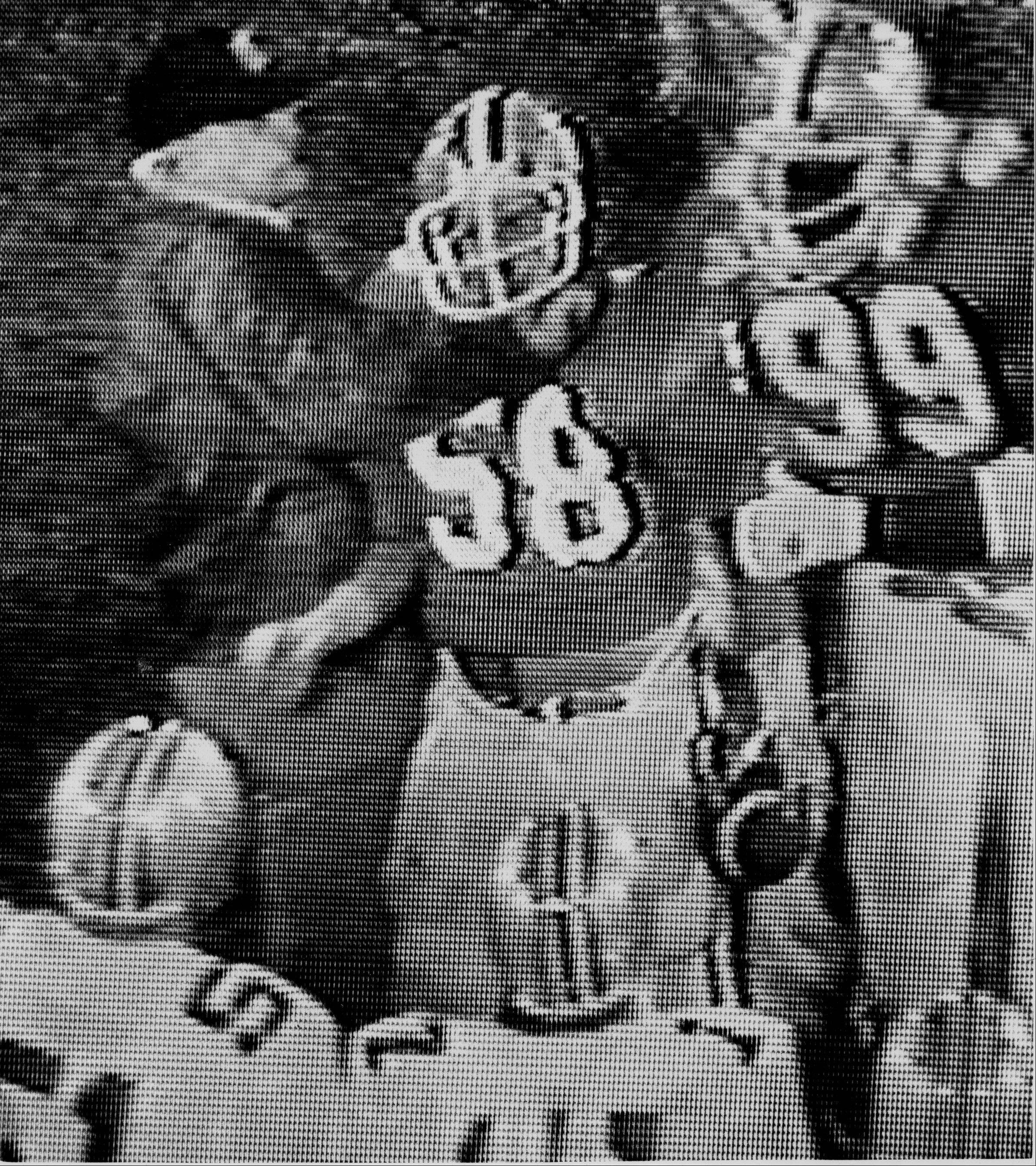 A shot from a monitor at the ABC studios in Washingtom shows Ohio State University coach Woody Hayes, left, after he struck Clemson player Charlie Bauman on the sideline at the 1978 Gator Bowl in Jacksonville, Fl