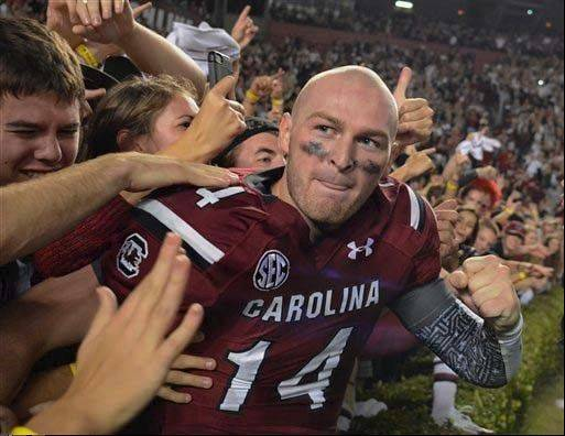 South Carolina quarterback Connor Shaw celebrates the Gamecocks' 19-14 win over Florida on Nov. 16. The senior threw for 2,135 yards and 21 TDs this season.