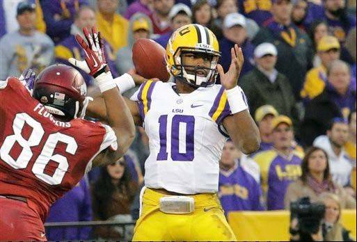 LSU quarterback Anthony Jennings throws a pass as Arkansas defensive end Trey Flowers rushes in during the second half of the Nov. 29 game in Baton Rouge, La.